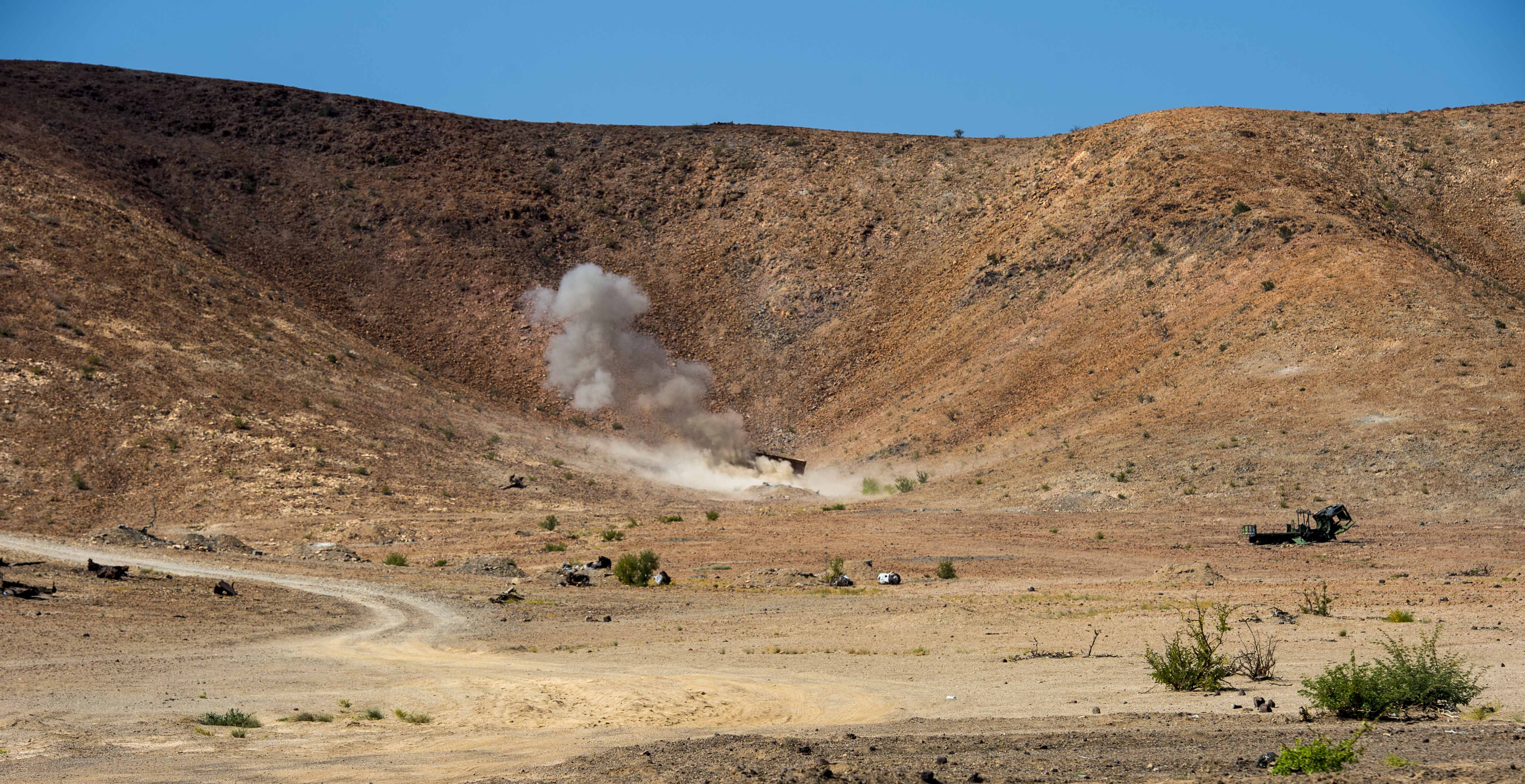 The Combined Joint Task Force- Horn of Africa Explosive Ordnance Disposal team detonates unexploded ordnance (UXO) found during range clearing near Camp Lemonnier, Djibouti, Nov. 6, 2017. Teams from the U.S. and France spent the day sweeping cordoned sections of the range and detonating UXO found in the area. The mission promotes partnerships between the two militaries while providing safer routes of travel through the area. (U.S. Air Force photo by Staff Sgt. Timothy Moore