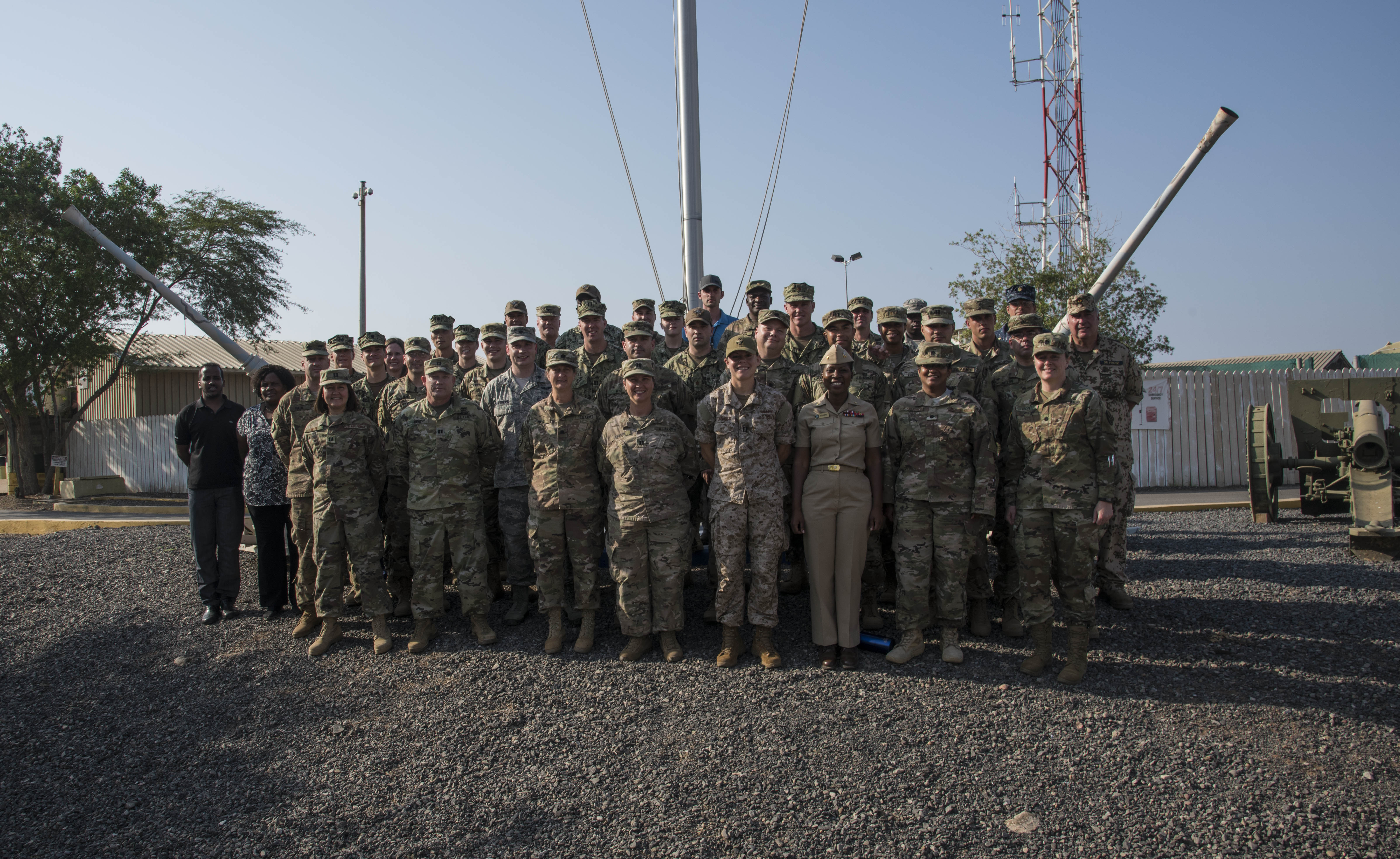 Medical professionals from across the U.S. military services, foreign militaries and local community pose for a group photo during the Military Tropical Medicine Course at Camp Lemonnier, Djibouti, Nov. 16, 2017. The Combined Joint Task Force – Horn of Africa Surgeon Cell collaborated with the Navy Medicine Professional Development Center to develop the three-day course, which discussed challenges posed to medical personnel providing care for troops operating within the Horn of Africa and the East African region. (U.S. Air National Guard photo by Staff Sgt. Allyson L. Manners)