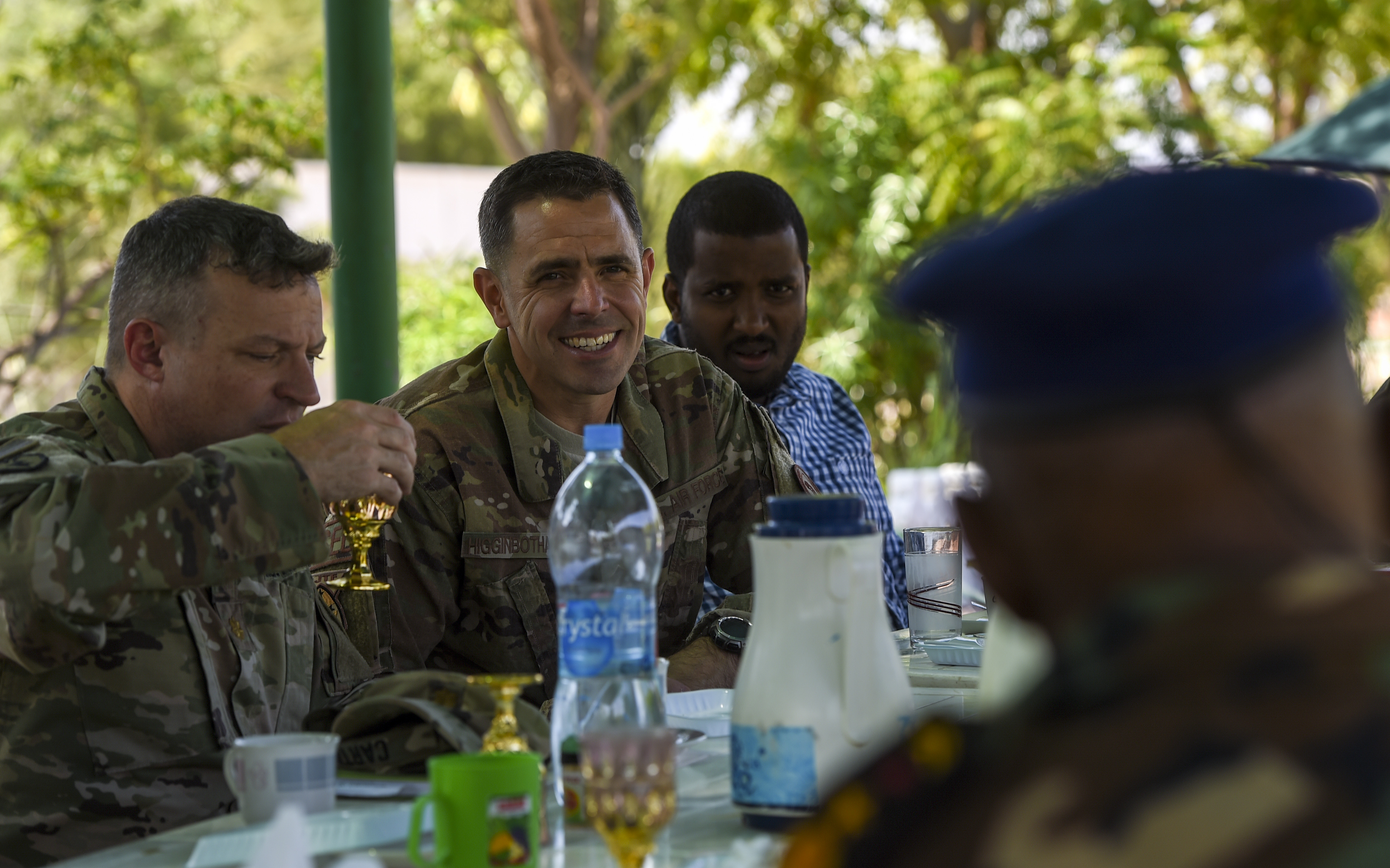 U.S. Air Force Chief Master Sgt. Benjamin Higginbotham, Combined Joint Task Force - Horn of Africa command senior enlisted leader, listens to Djibouti Armed Forces (FAD) Lt. Col. A. Omar during a visit to the FAD military training center at Holhol, Djibouti, Nov. 14, 2017. Higginbotham accompanied leaders of the Kentucky National Guard as they visited their FAD partners. The Kentucky National Guard and the FAD are partners through the State Partnership Program. (U.S. Air Force photo by Staff Sgt. Timothy Moore)