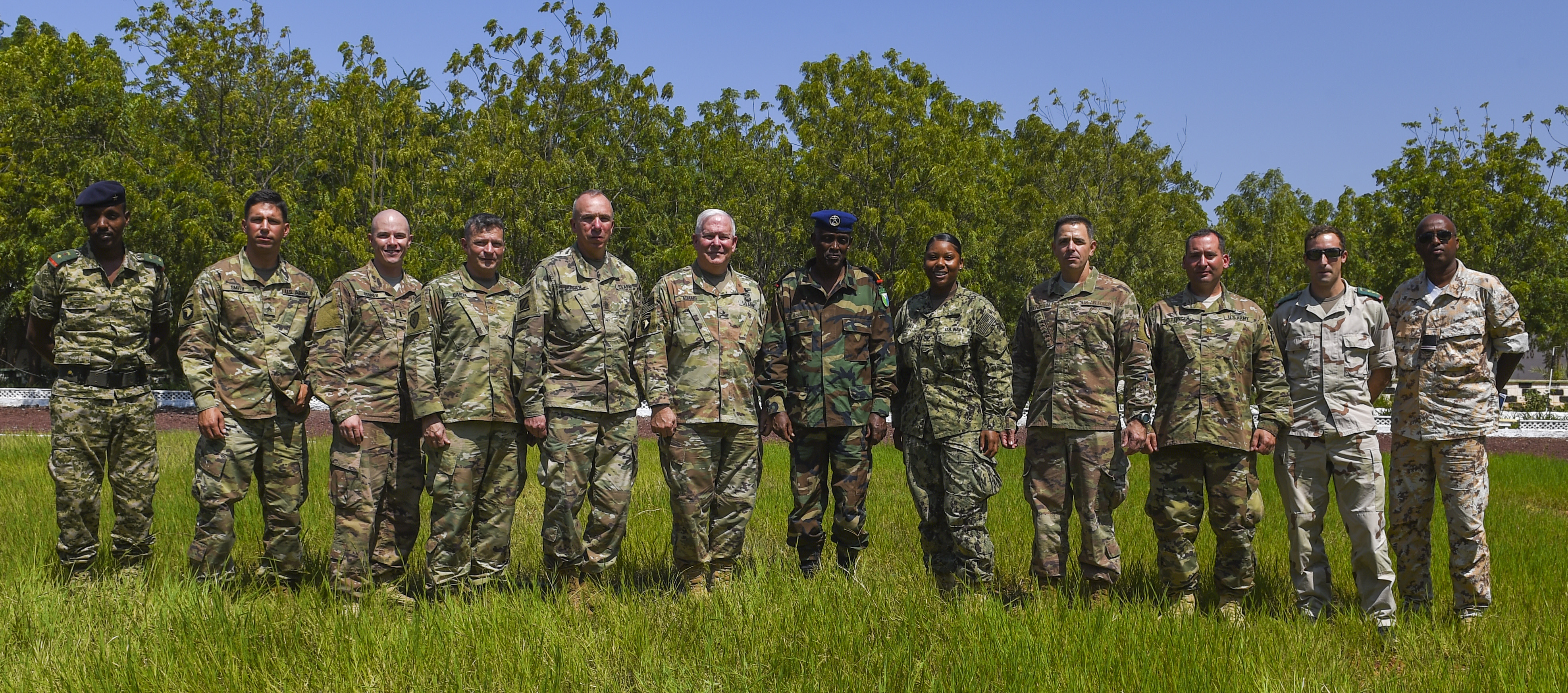 Members of the Combined Joint Task Force - Horn of Africa, Kentucky National Guard, Djibouti Armed Forces (FAD), and French army pose for a group photo during a visit to the FAD military training center at Holhol, Djibouti, Nov. 14, 2017.  The visit was part of the State Partnership Program, which matches a U.S. state's National Guard with a nation to promote enduring, mutually beneficial security relationships. (U.S. Air Force photo by Staff Sgt. Timothy Moore)