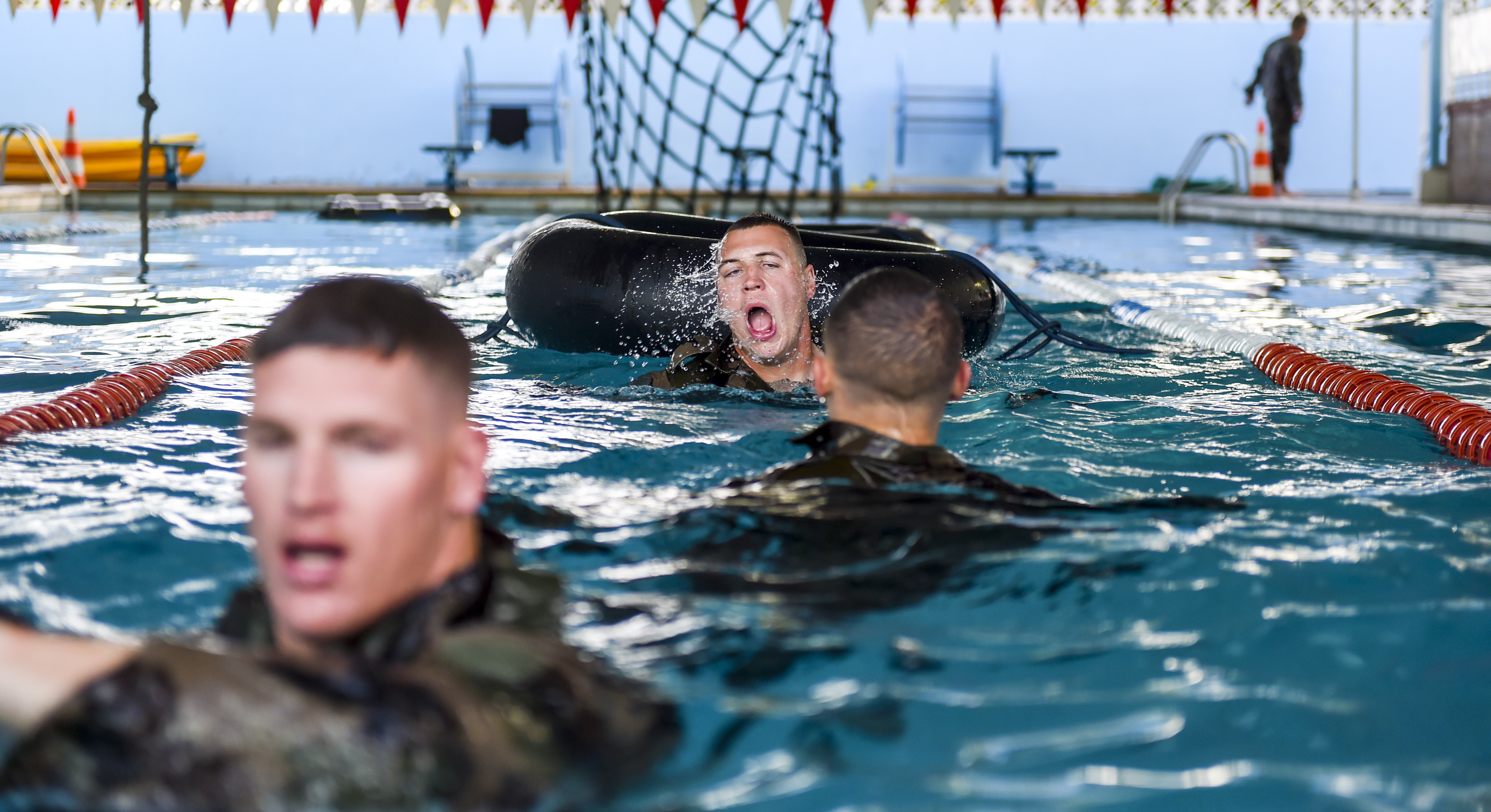 A U.S. Army National Guard Soldier assigned to the 3rd Battalion, 144th Infantry Regiment, Task Force Bayonet, Camp Lemonnier, Djibouti, surfaces for air after swimming through an inner tube during a French Desert Commando Course prequalification assessment at Montclair, Djibouti, Nov. 22, 2017. Along with French marines assigned to the 5th Overseas Interarms Regiment, Djibouti, 30 Task Force Bayonet Soldiers competed in the assessment as a prerequisite to participating in the two-week French Desert Commando Course, which includes desert, water, and mountain portions. (U.S. Air Force photo by Staff Sgt. Timothy Moore)