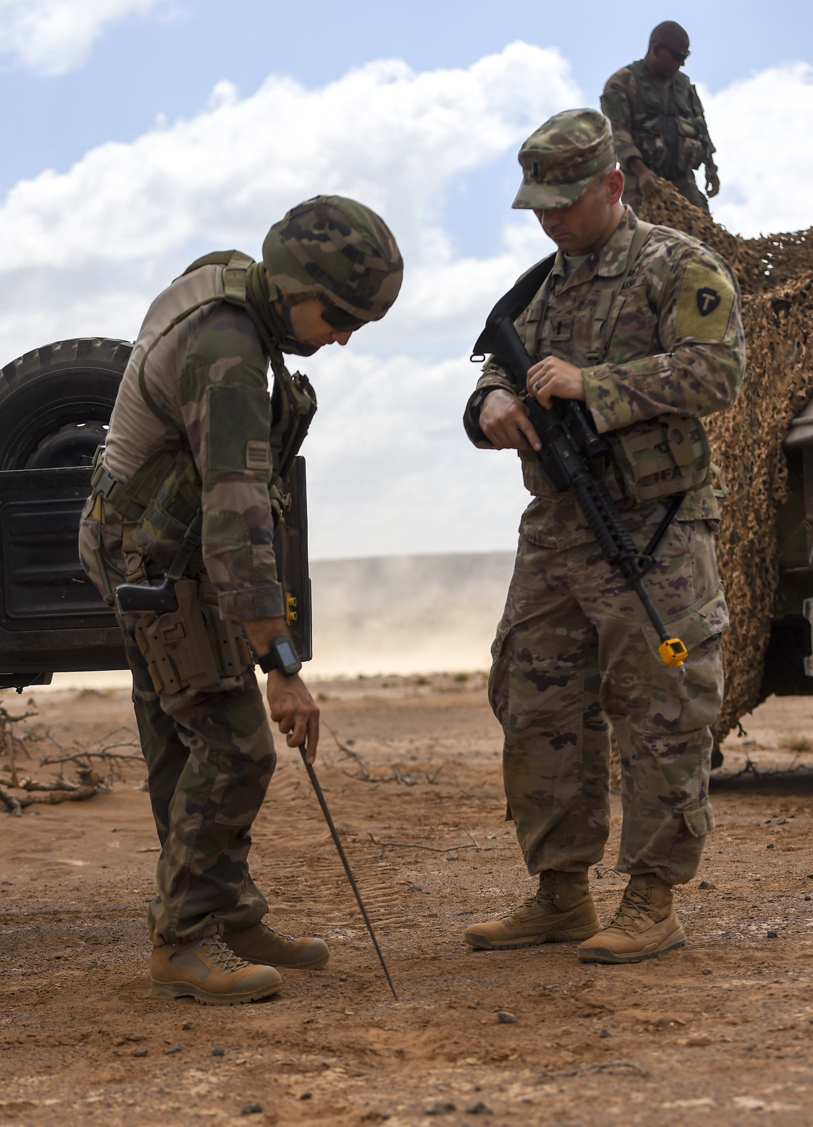 U.S. Army National Guard 1st Lt. Joshua York (right), 3rd Battalion, 144th Infantry Regiment, Task Force Bayonet platoon leader, discusses training logistics with his French counterpart on the first day of a French Desert Commando Course at the Djibouti Range Complex near Arta, Djibouti, Nov. 26, 2017. The 12-day course will expose service members to the fundamentals of desert combat, survival, and troop movements while also bridging language and cultural barriers between the French and American troops. (U.S. Air Force photo by Staff Sgt. Timothy Moore)