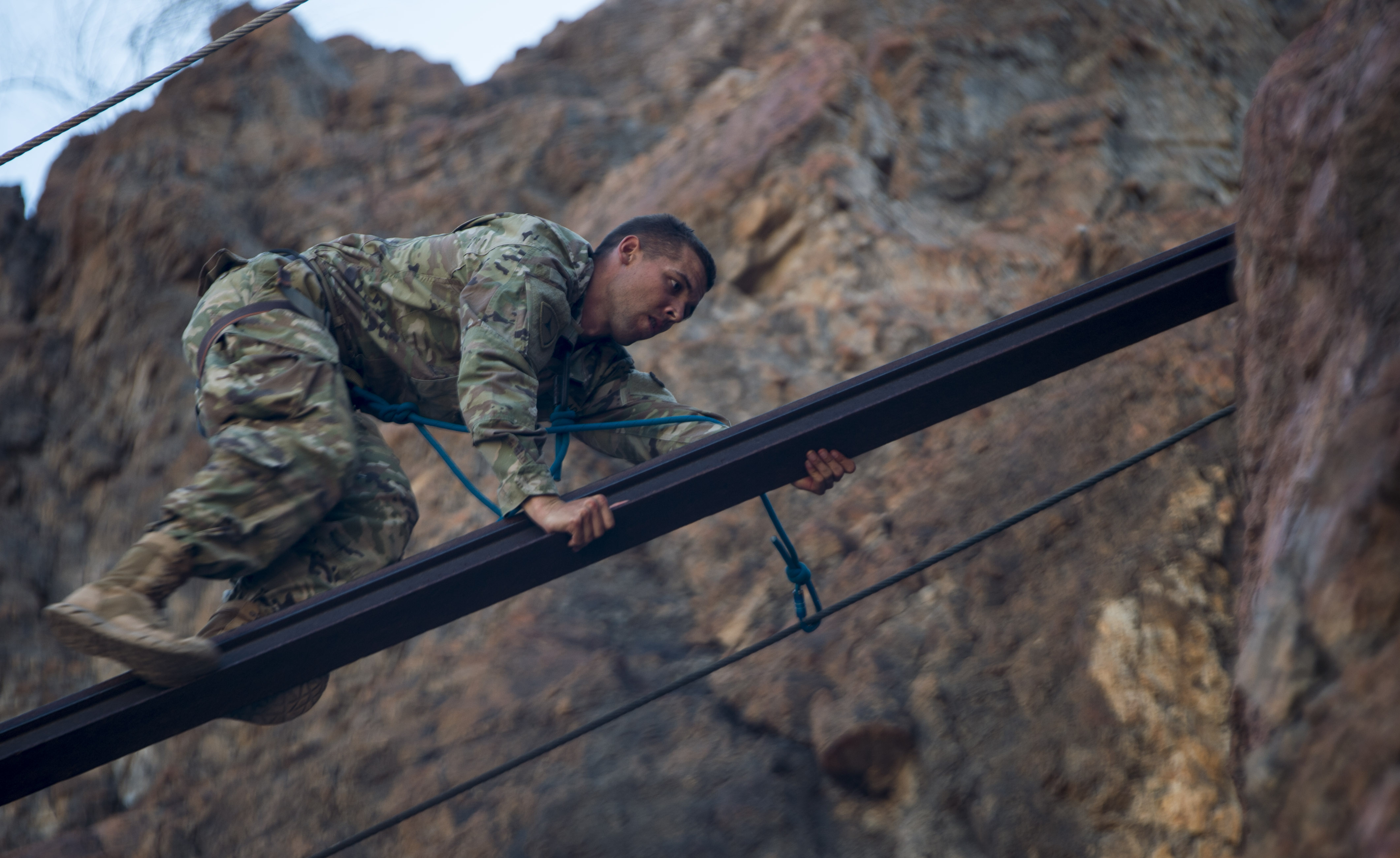 A U.S. Army Soldier assigned to the 3rd Battalion, 144th Infantry Regiment Task Force Bayonet, attached to the Combined Joint Task Force - Horn of Africa, climbs across a beam during the mountain obstacle portion of the French Desert Commando Course held at Arta, Djibouti, Dec. 3, 2017.Thirty U.S. service members participated in the obstacle course alongside French marines assigned to the 5th Overseas Interarms Regiment, Djibouti. (U.S. Air Force photo by Staff Sgt. Timothy Moore)