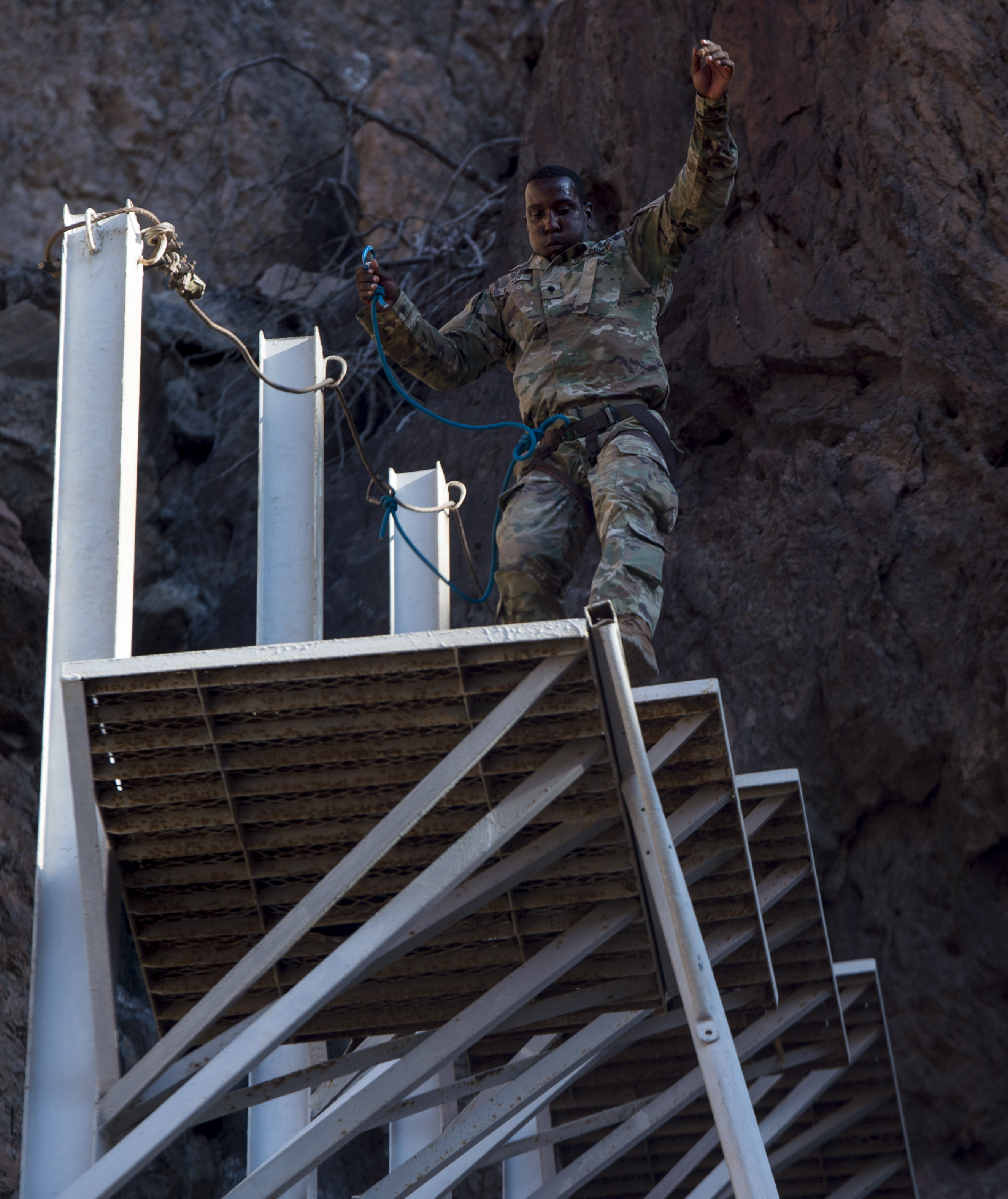 A U.S. Army Soldier assigned to the 3rd Battalion, 144th Infantry Regiment Task Force Bayonet, attached to the Combined Joint Task Force - Horn of Africa, jumps from one platform to another during the mountain obstacle portion of the French Desert Commando Course held at Arta, Djibouti, Dec. 3, 2017.Thirty U.S. service members participated in the obstacle course alongside French marines assigned to the 5th Overseas Interarms Regiment, Djibouti. (U.S. Air Force photo by Staff Sgt. Timothy Moore)