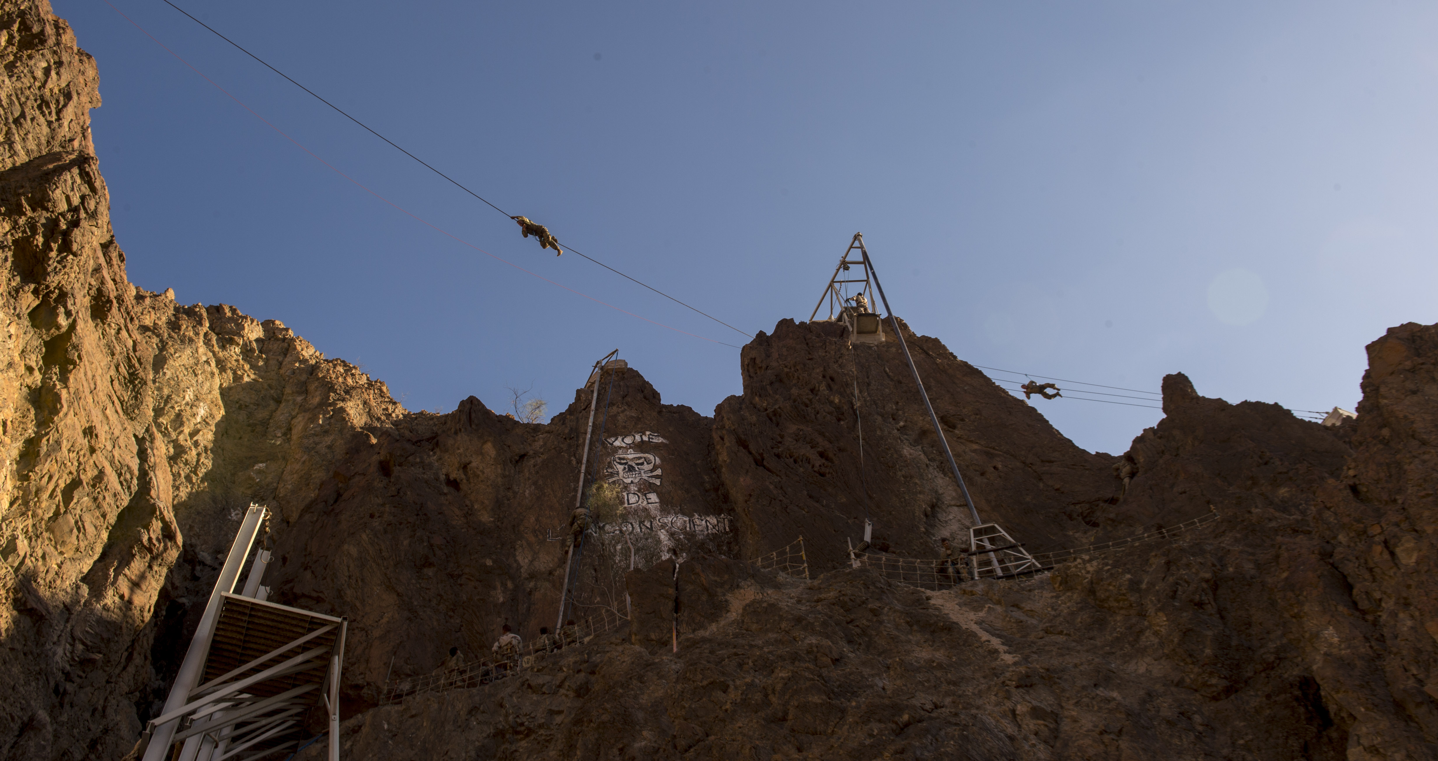 U.S. service members assigned to the Combined Joint Task Force - Horn of Africa, navigate various mountain obstacles during the French Desert Commando Course held at Arta, Djibouti, Dec. 3, 2017. Thirty U.S. service members participated in the obstacle course alongside French marines assigned to the 5th Overseas Interarms Regiment, Djibouti. (U.S. Air Force photo by Staff Sgt. Timothy Moore)