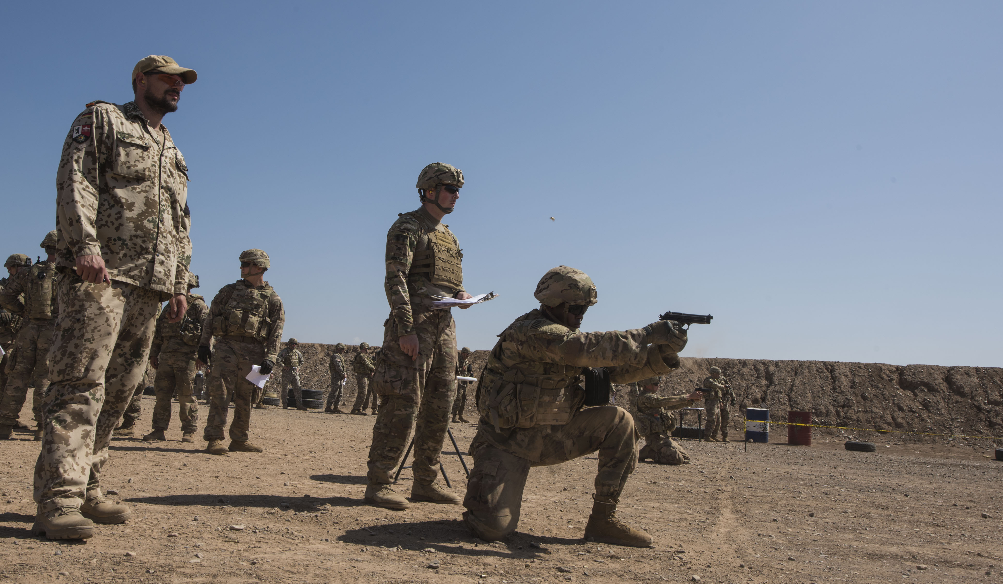 U.S. service members assigned to Combined Joint Task Force-Horn of Africa complete a weapons qualification test as part of the competition to earn the German Armed Forces Proficiency Badge (GAFPB), a decoration of the Armed Forces of the Federal Republic of Germany, at the Djiboutian National Police firing range in Djibouti City, Djibouti, Nov. 29, 2017. Competitors must complete a physical fitness test, uniformed swim, weapons qualification, ruck march, first aid course and chemical warfare course to be awarded the GAFPB, one of the few foreign allied military awards that U.S. service members are authorized to wear. (U.S. Air National Guard photo by Staff Sgt. Allyson L. Manners)