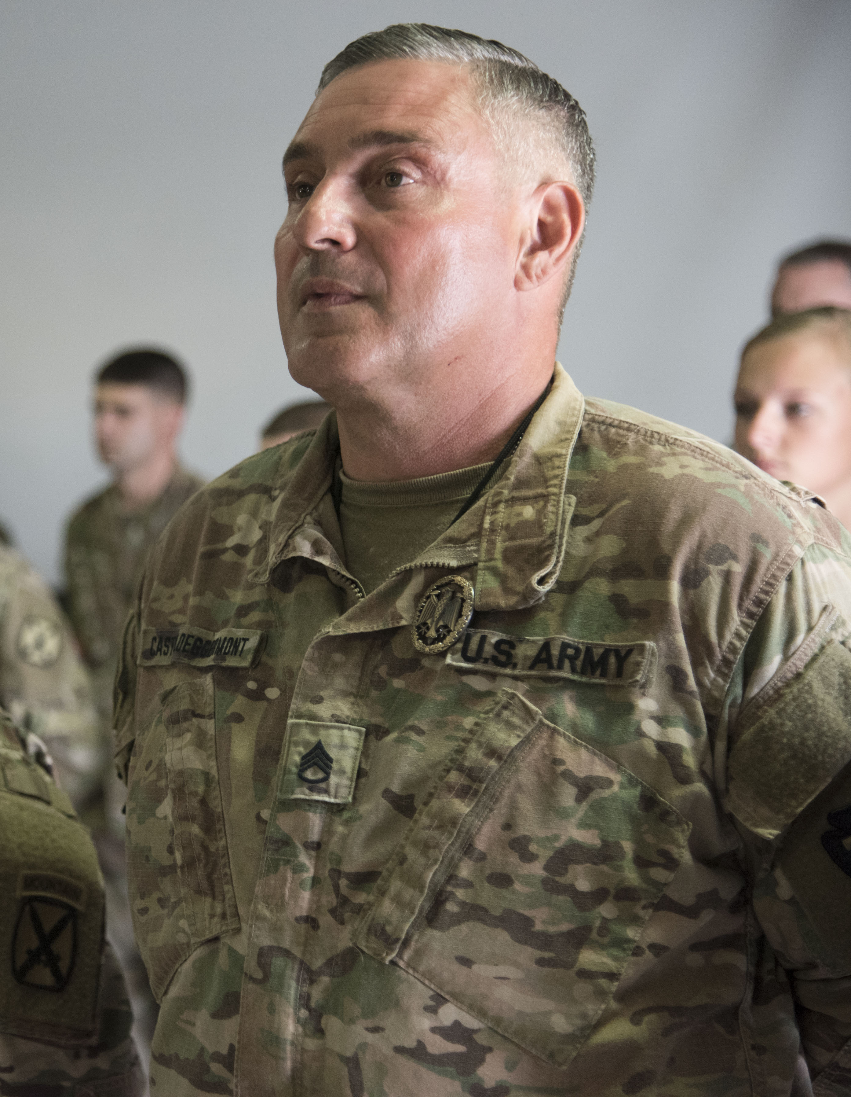 U.S. Army Staff Sgt. John Castilloeggermont, assigned to Combined Joint Task Force-Horn of Africa, wears the German Armed Forces Proficiency Badge (GAFPB) on his collar at Camp Lemonnier, Djibouti, Dec. 8, 2017. Competitors completed a physical fitness test, uniformed swim, weapons qualification, ruck march, first aid course and chemical warfare course to be awarded the GAFPB, a decoration of the Armed Forces of the Federal Republic of Germany and one of the few foreign allied military awards that U.S. service members are authorized to wear. (U.S. Air National Guard photo by Staff Sgt. Allyson L. Manners)