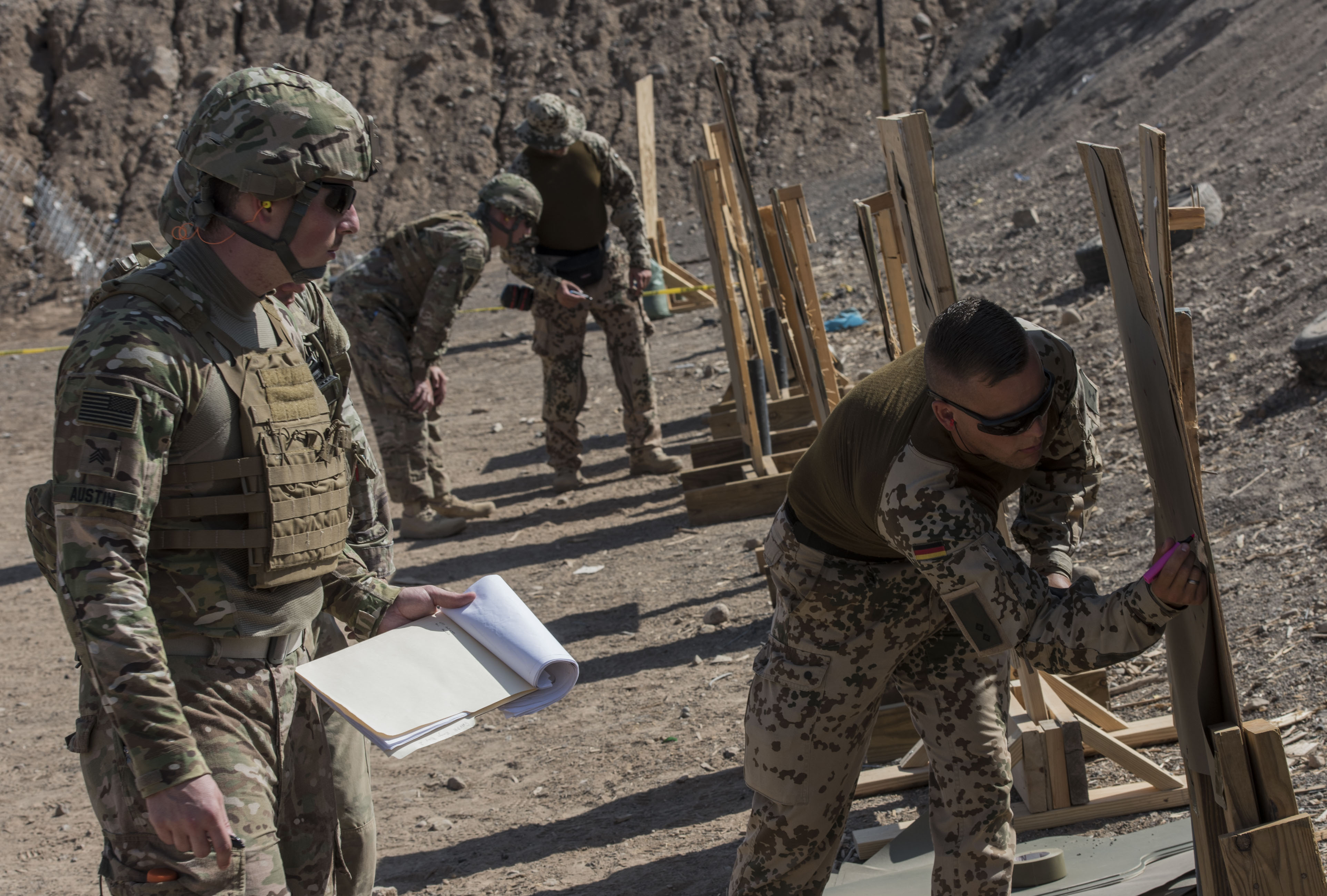 U.S. service members assigned Combined Joint Task Force-Horn of Africa complete a weapons qualification test as part of the competition to earn the German Armed Forces Proficiency Badge (GAFPB), a decoration of the Armed Forces of the Federal Republic of Germany, at the Djiboutian National Police firing range in Djibouti City, Djibouti, Nov. 29, 2017. Competitors must complete a physical fitness test, uniformed swim, weapons qualification, ruck march, first aid course and chemical warfare course to be awarded the GAFPB, one of the few foreign allied military awards that U.S. service members are authorized to wear. (U.S. Air National Guard photo by Staff Sgt. Allyson L. Manners)