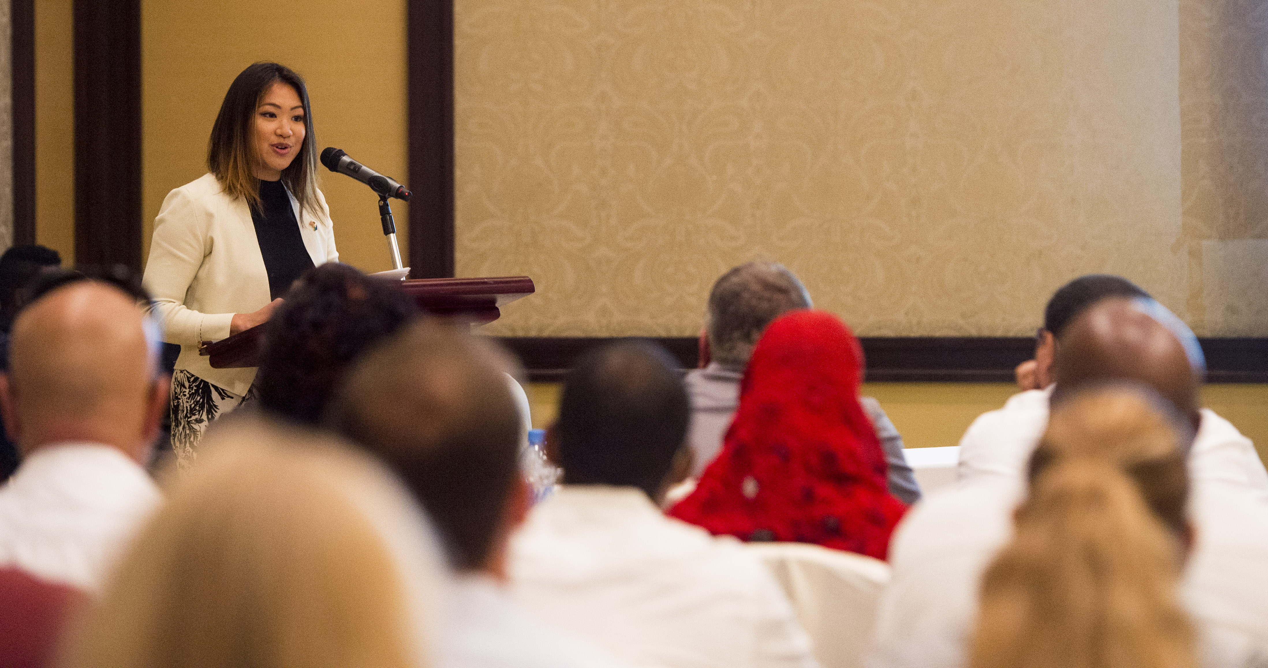 Merry Walker, U.S. Embassy Djibouti Economic and Commercial Officer, gives her opening remarks during an Economic Outreach Symposium held at the Kempinski Hotel, Djibouti, Dec. 19, 2017. Hosted by the Combined Joint Task Force - Horn of Africa Contingency Contracting Office and commonly referred to as Vendor Day, the symposium is designed to bring local business owners together and inform them of the opportunities and processes of doing business as a vendor with the U.S. government. (U.S. Air Force photo by Staff Sgt. Timothy Moore)