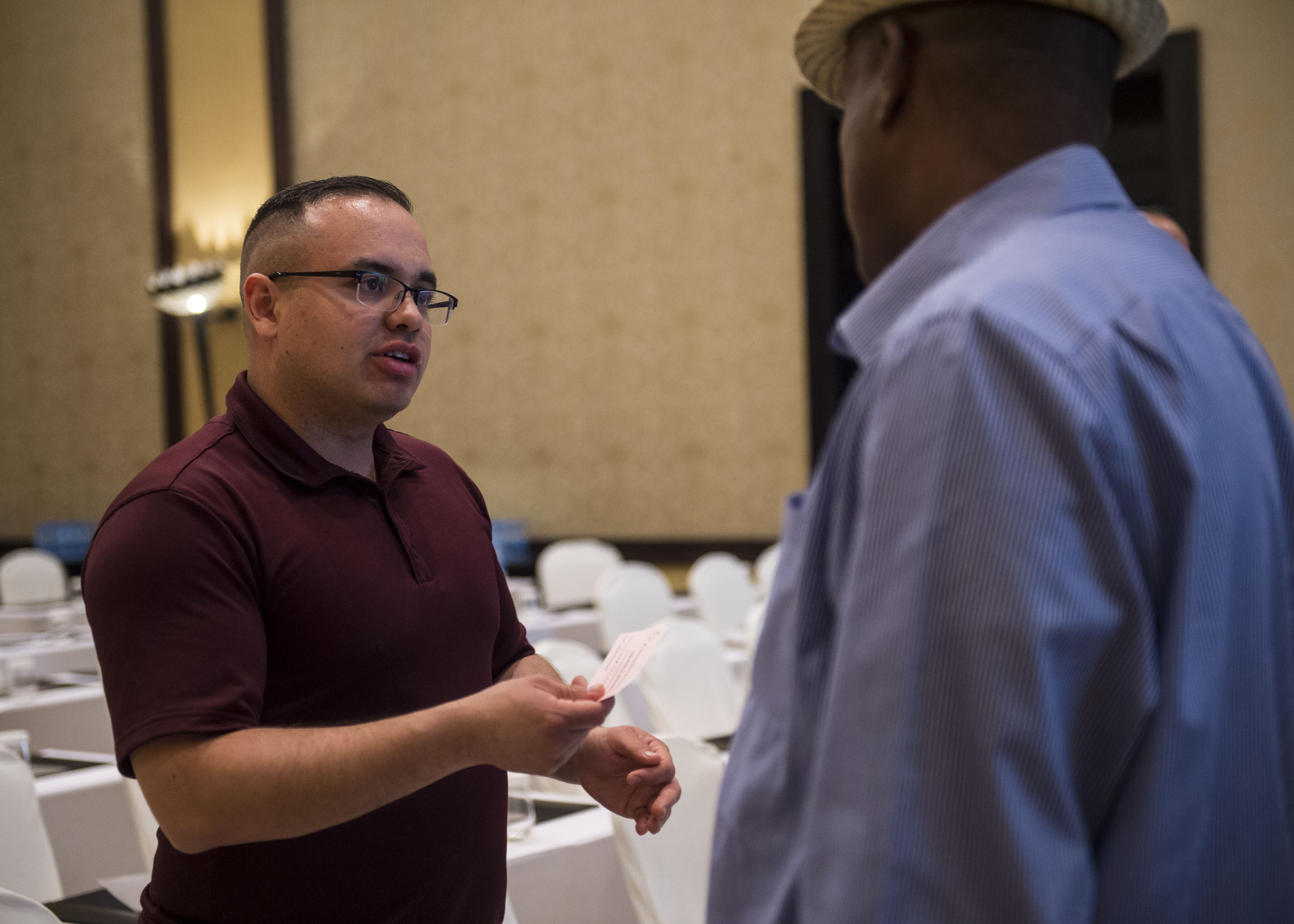 U.S. Army Staff Sgt. Uriel Ramirez, Combined Joint Task Force - Horn of Africa (CJTF-HOA) Contingency Contracting Office (CCO) contracting officer, talks with a representative from a local business during a Djibouti Economic Outreach Symposium in Ilon Du Heron, Djibouti, Dec. 19, 2017. Hosted by the CJTF-HOA CCO and commonly referred to as Vendor Day, the symposium is designed to get local business owners together and make them aware of the opportunities and process of doing business as a vendor with the U.S. government. (U.S. Air Force photo by Staff Sgt. Timothy Moore)
