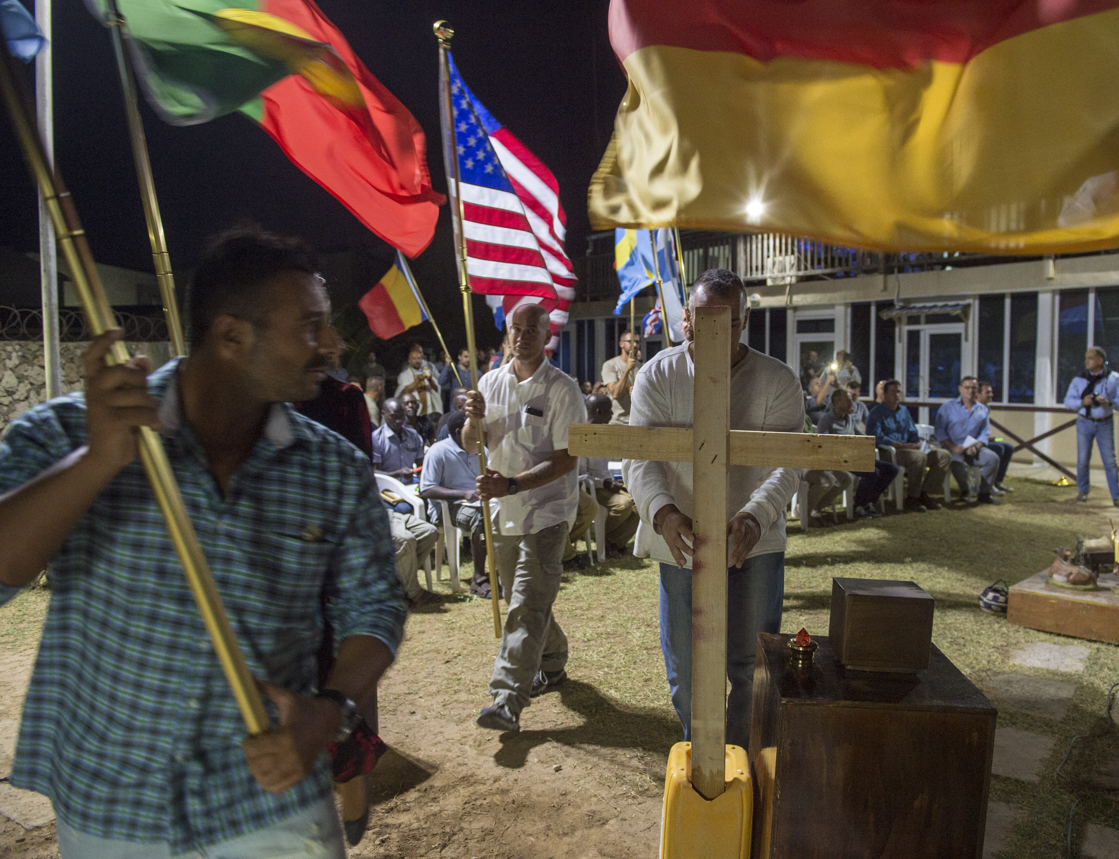 U.S. service members assigned to Combined Joint Task Force - Horn of Africa, along side service members from partner nations, take part in a Christmas Eve service in Mogadishu, Somalia, Dec. 24, 2017.  Service members are taking time to connect with each other and with family members back home as they head into the new year, continuing their dedication to protecting the U.S. and strengthening relationships with partnered nations. (U.S. Air Force photo by Staff Sgt. Timothy Moore)