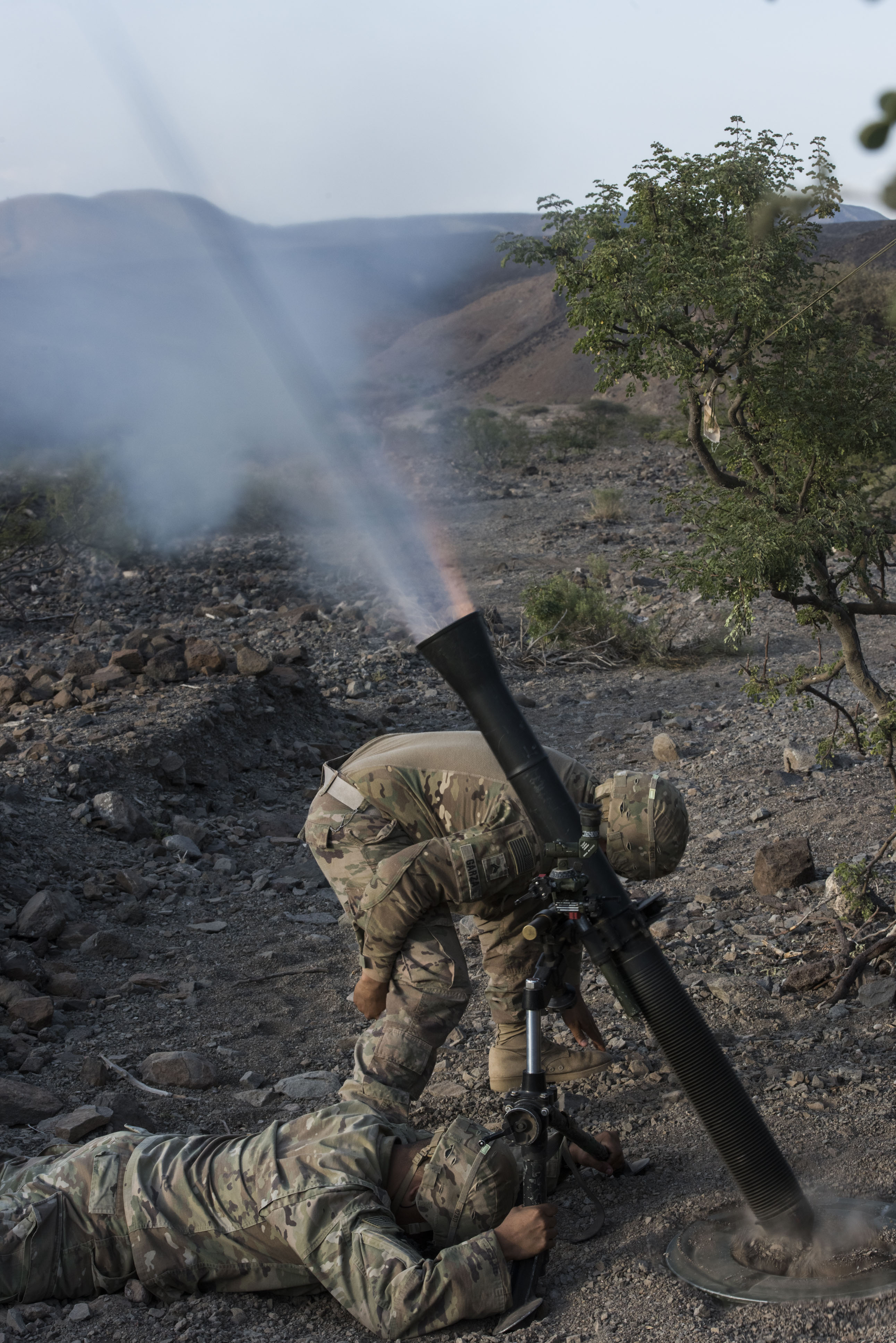 U.S. Army Soldiers with 3rd Battalion, 144th Infantry Regiment, assigned to Task Force Bayonet, Combined Joint Task Force - Horn of Africa, fire a mortar as part of a live-fire combat rehearsal during Alligator Dagger at Arta Range, Djibouti, Dec. 17, 2017. Alligator Dagger, led by Naval Amphibious Force, Task Force 51/5th Marine Expeditionary Brigade, is a dedicated, bilateral combat rehearsal that combines U.S. and French forces to practice, rehearse and exercise integrated capabilities available to U.S. Central Command both afloat and ashore. (U.S. Air Force photo by Staff Sgt. Allyson L. Manners)