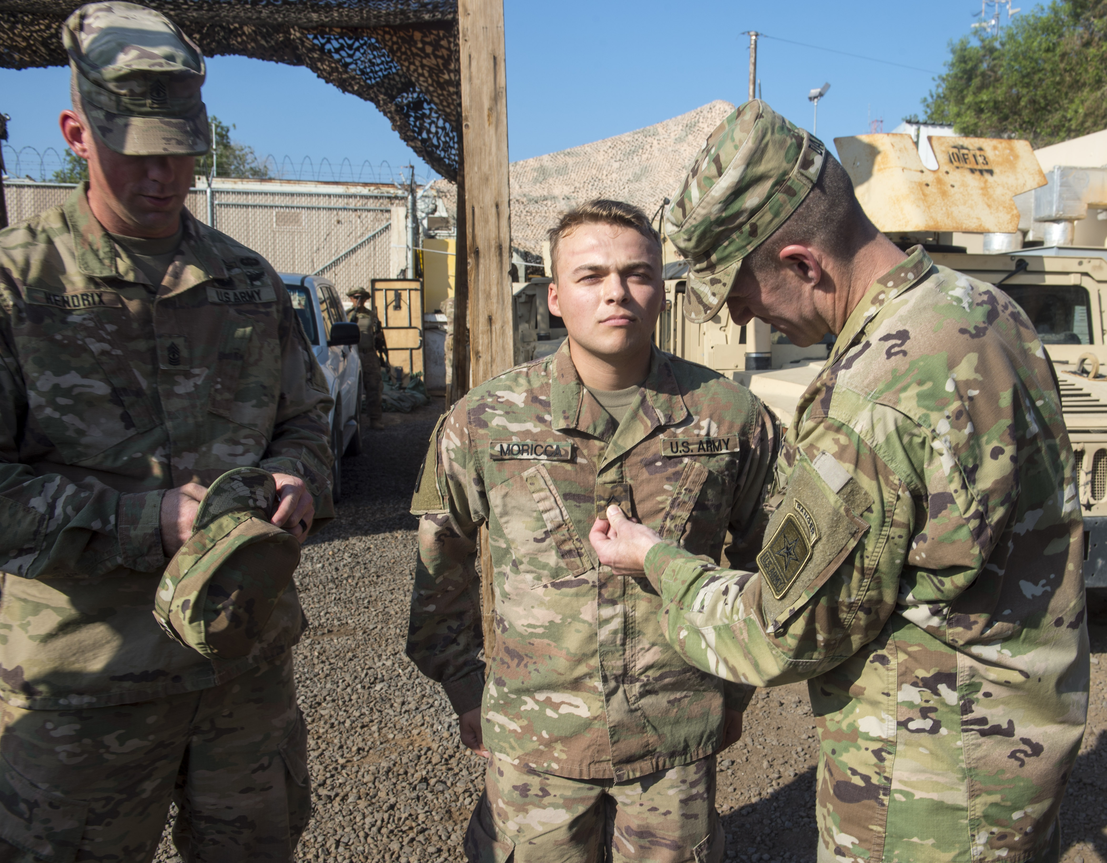 U.S. Sgt. Maj. of the Army Daniel Dailey pins on the rank of a newly promoted Soldier assigned to Combined Joint Task Force - Horn of Africa at Camp Lemonnier, Djibouti, Dec. 21, 2017. Camp Lemonnier was Dailey's last stop before returning to the United States as he visited with Soldiers and other service members deployed and away from their families during the holidays. (U.S. Air Force photo by Staff Sgt. Timothy Moore)