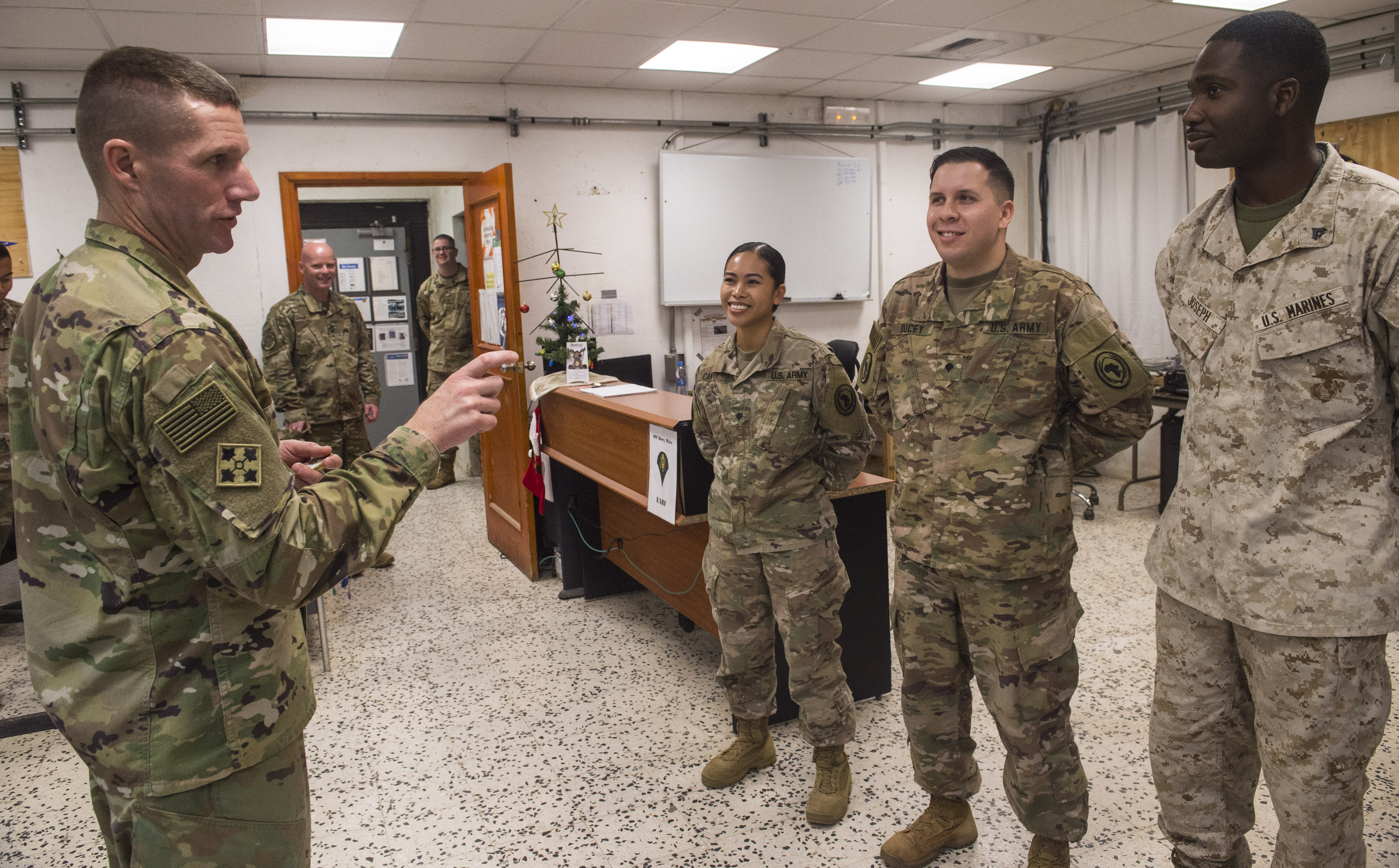 U.S. Sgt. Maj. of the Army Daniel Dailey recognizes top-performing service members assigned to Combined Joint Task Force - Horn of Africa during his visit to Camp Lemonnier, Djibouti, Dec. 21, 2017. Camp Lemonnier was Dailey's last stop before returning to the United States as he visited with Soldiers and other service members deployed and away from their families during the holidays. (U.S. Air Force photo by Staff Sgt. Timothy Moore)