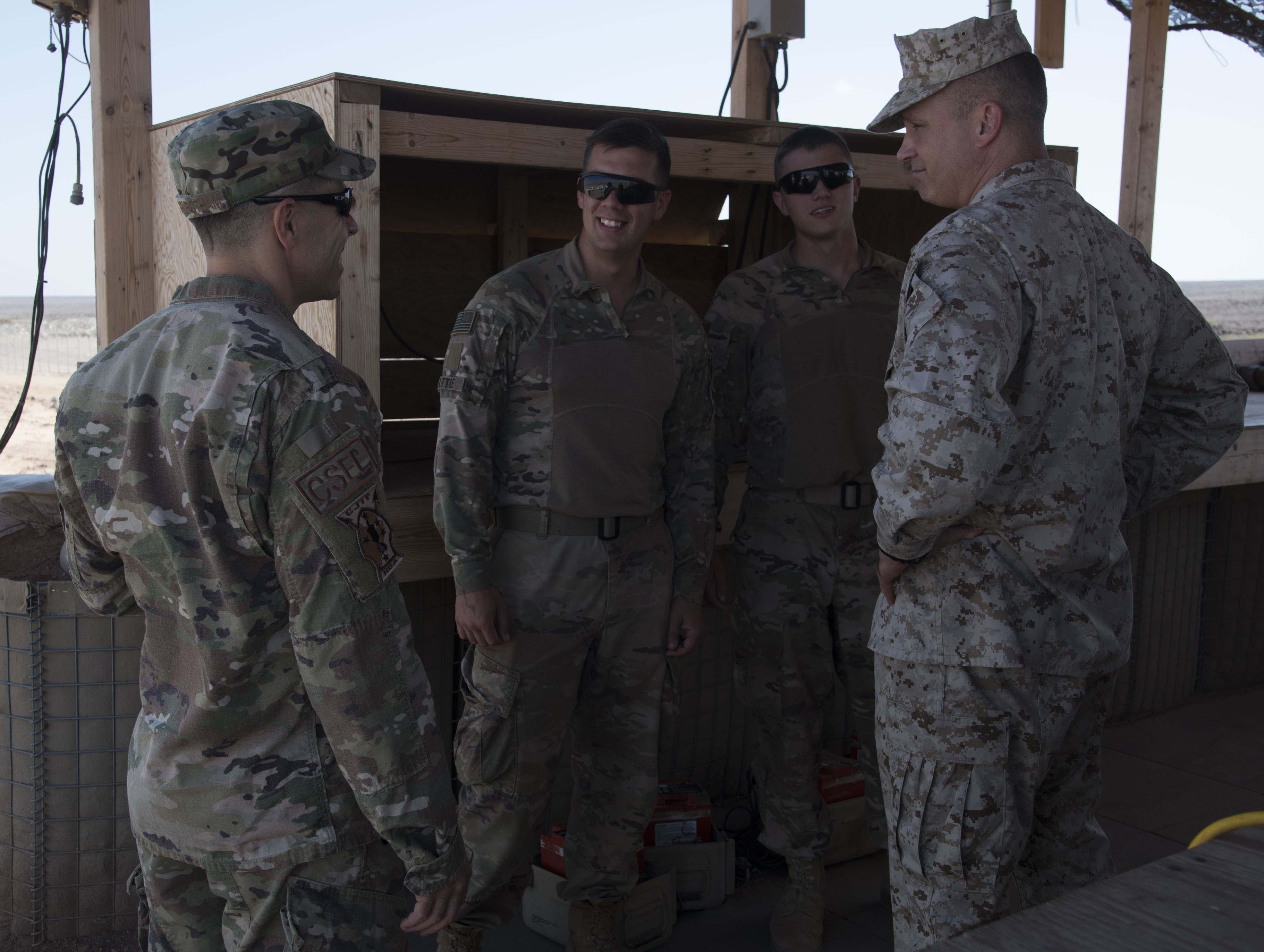 U.S. Marine Corps Brig. Gen. David J. Furness, commander of Combined Joint Task Force – Horn of Africa, and U.S. Air Force CommandChief Master Sgt. Benjamin J. Higginbotham, command senior enlisted leader of CJTF-HOA,  visit with troops in Chebelley, Djibouti, Dec. 25, 2017.  The leaders spent the afternoon meeting with service members and thanking them for their continued service and sacrifice throughout the holiday season. (U.S. Air National Guard photo by Staff Sgt. Allyson L. Manners)