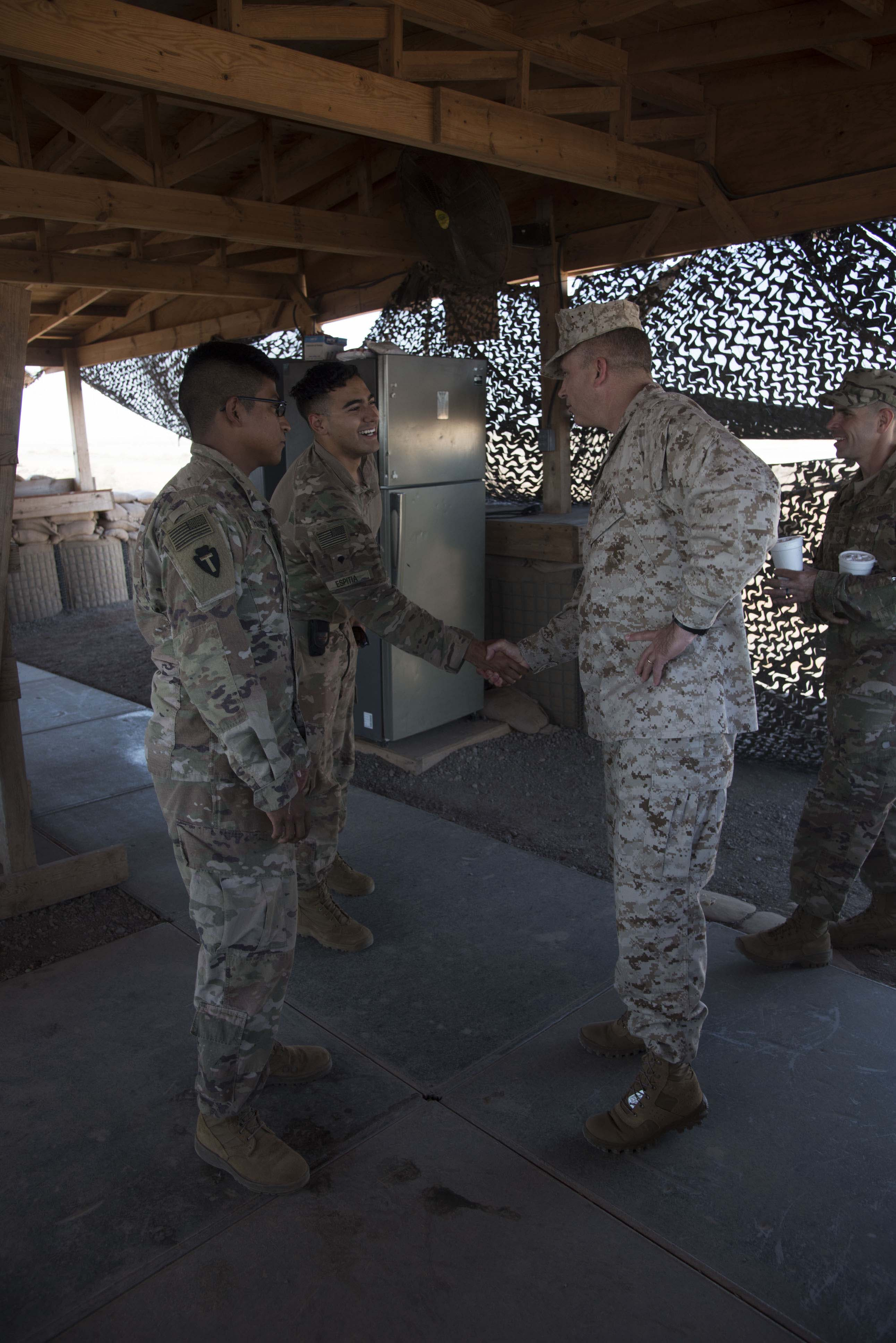 U.S. Marine Corps Brig. Gen. David J. Furness, commander of Combined Joint Task Force – Horn of Africa, and U.S. Air Force Command Chief Master Sgt. Benjamin J. Higginbotham, command senior enlisted leader of CJTF-HOA, serve lunch and visit with troops in Chebelley, Djibouti, Dec. 25, 2017.  The leaders spent the afternoon  meeting with service members and thanking them for their continued service and sacrifice throughout the holiday season. (U.S. Air National Guard photo by Staff Sgt. Allyson L. Manners)
