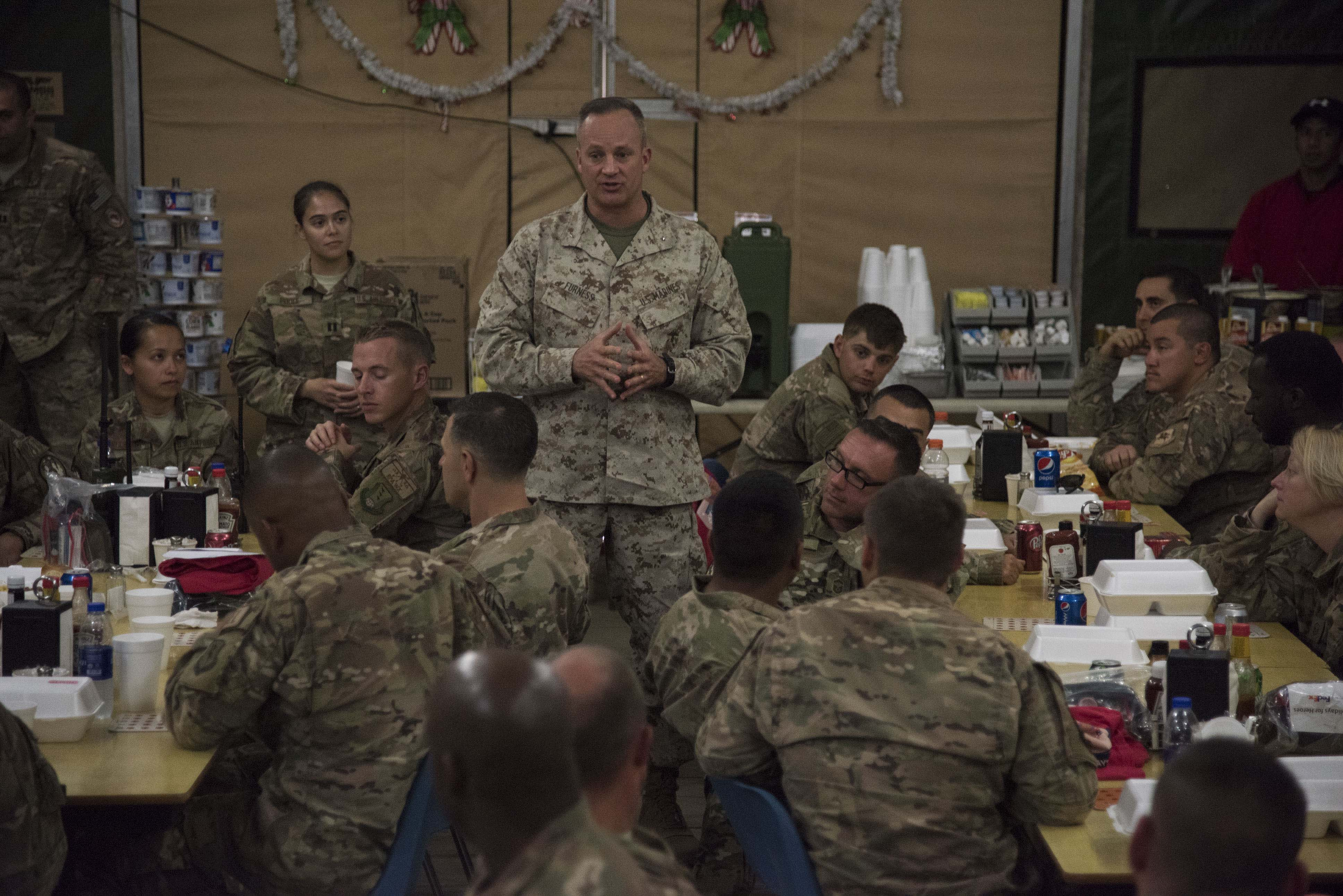 U.S. Marine Corps Brig. Gen. David J. Furness, commander of Combined Joint Task Force – Horn of Africa, speaks with troops after serving them lunch near Camp Lemonnier, Djibouti, Dec. 25, 2017.  Furness spent the afternoon meeting with service members and thanking them for their continued service and sacrifice throughout the holiday season. (U.S. Air National Guard photo by Staff Sgt. Allyson L. Manners)
