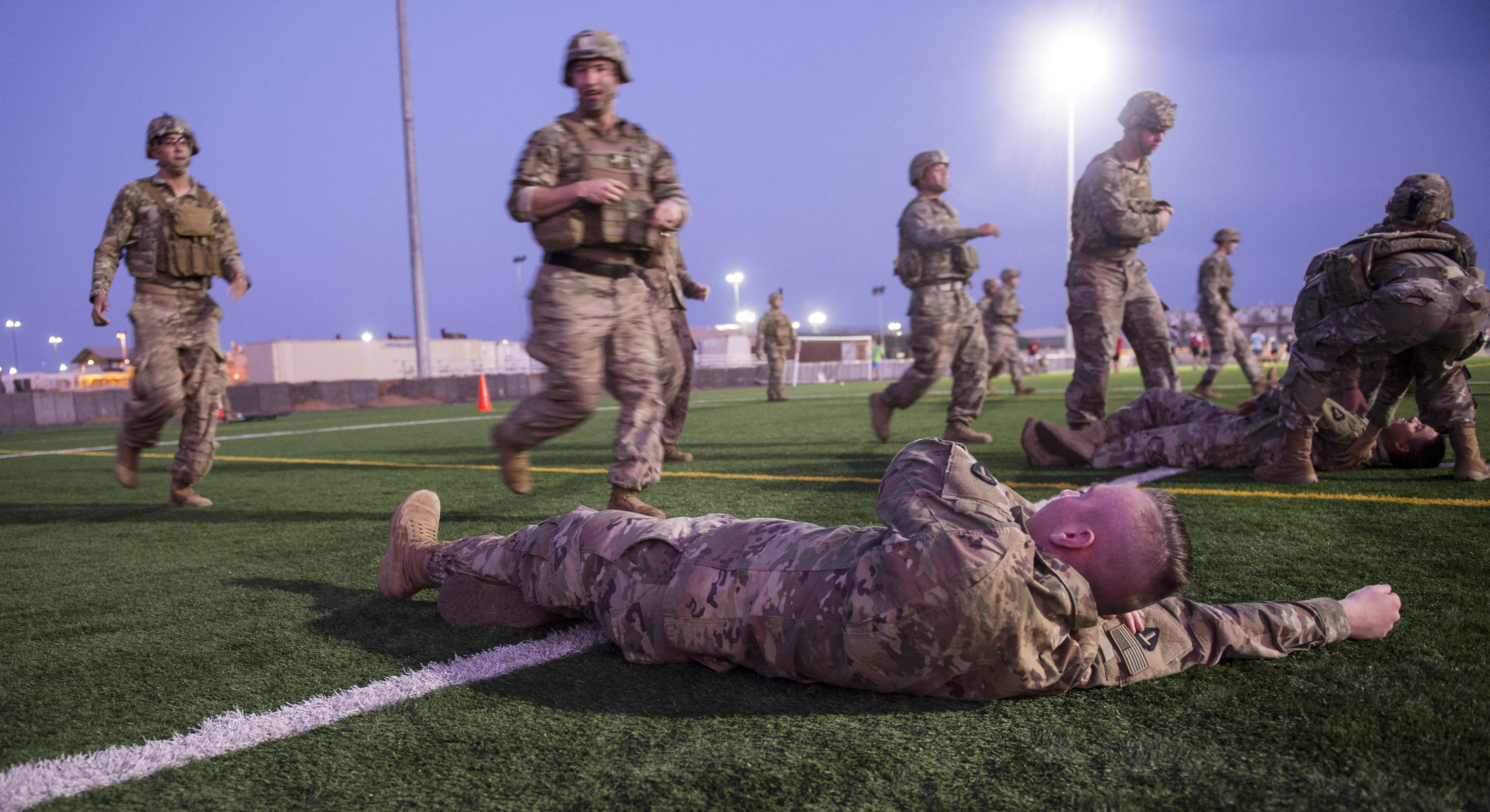 U.S. Army site security team Soldiers assigned to Task Force Bayonet, Combined Joint Task Force - Horn of Africa, move to assess and transport simulated casualties during a Combat Lifesaver (CLS) training event at Camp Lemonnier, Djibouti, Dec. 30, 2017. Participants demonstrated CLS principals while in care under fire, tactical field care, and tactical evacuation care scenarios. (U.S. Air Force photo by Staff Sgt. Timothy Moore)