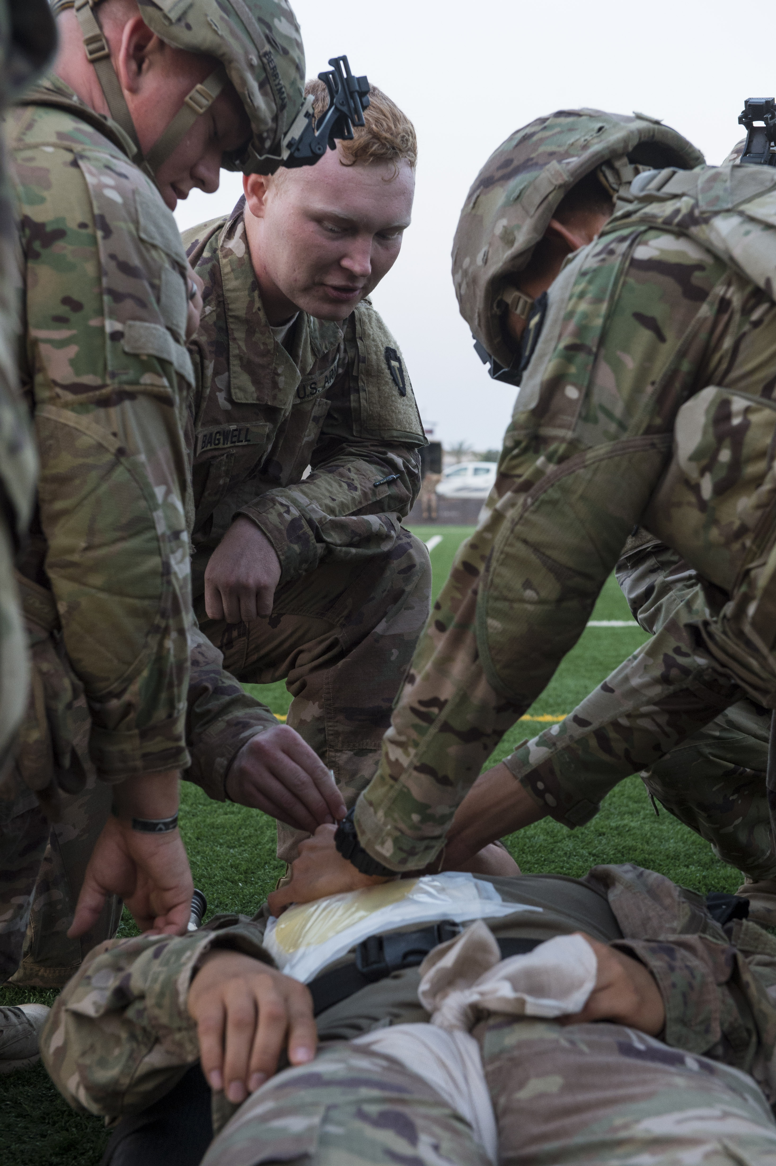 U.S. Army Spc. Alex Bagwell, a combat medic assigned to Task Force Bayonet, Combined Joint Task Force - Horn of Africa, instructs members of a site security team how to administer a chest decompression needle during a Combat Lifesaver (CLS) training event at Camp Lemonnier, Djibouti, Dec. 30, 2017. Participants demonstrated CLS principals during scenarios that simulated being under enemy fire, having the possibility to come under enemy fire, and moving casualties to medical facilities. (U.S. Air Force photo by Staff Sgt. Timothy Moore)