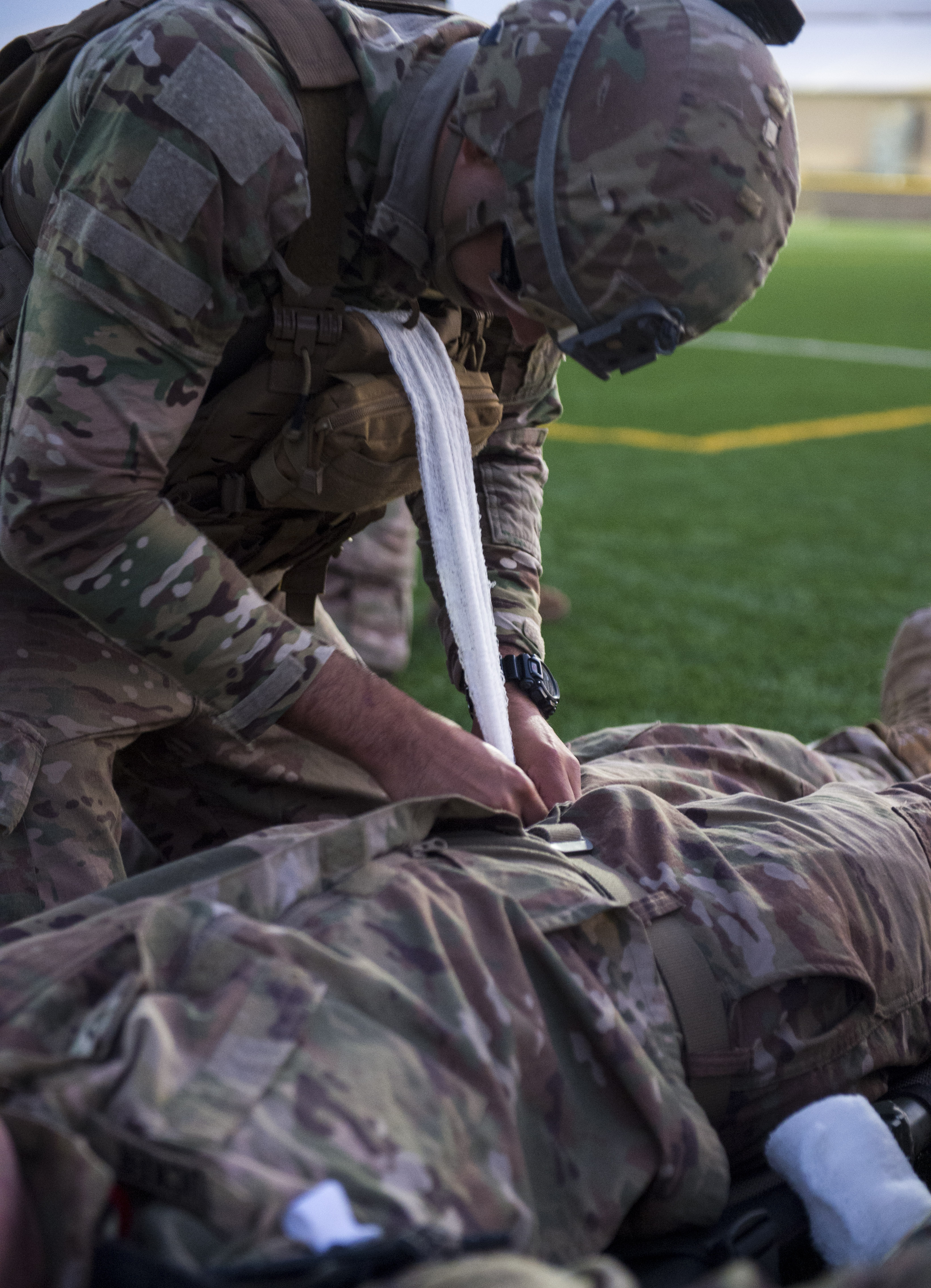 A U.S. Army site security team Soldier assigned to Task Force Bayonet, Combined Joint Task Force - Horn of Africa, simulates packing combat gauze into a simulated wound of a fellow Soldier during a Combat Lifesaver (CLS) training event at Camp Lemonnier, Djibouti, Dec. 30, 2017. Participants demonstrated CLS principals during scenarios that simulated being under enemy fire, having the possibility to come under enemy fire, and moving casualties to medical facilities. (U.S. Air Force photo by Staff Sgt. Timothy Moore)