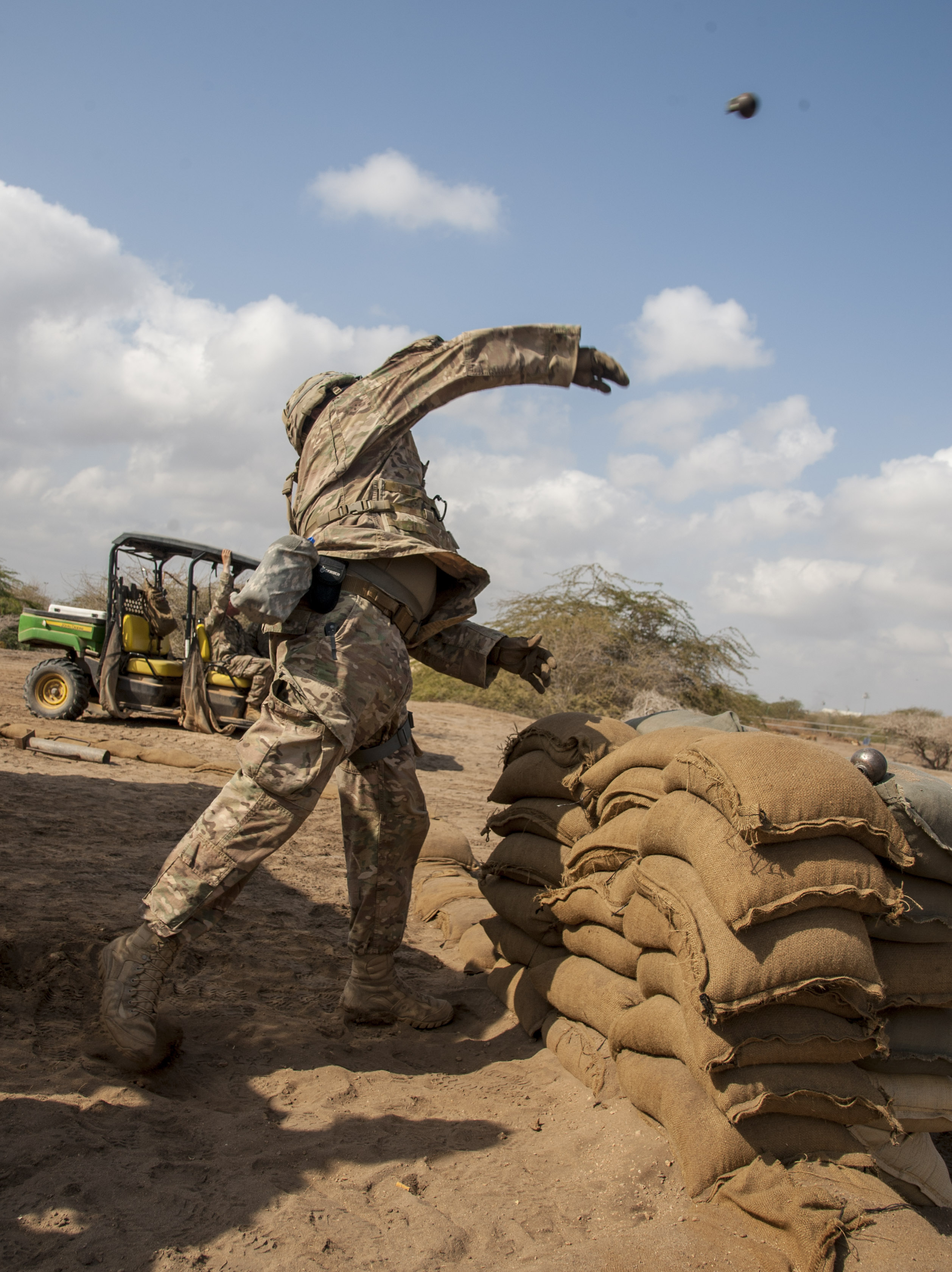 A U.S. Army Soldier assigned to Combined Joint Task Force - Horn of Africa throws a training grenade in preparation for an Expert Infantryman Badge (EIB) evaluation at Camp Lemonnier, Djibouti, Jan. 23, 2018. The EIB is a coveted special skills badge that requires infantry Soldiers to pass a five-day evaluation that consists of an Army Physical Fitness Test, day and night land navigation, a 12-mile forced march, and 30 individual tasks covering weapons, medical, and security patrol skills. In an April 2016 EIB iteration at Camp Lemonnier, only 15 percent of candidates earned the badge. (U.S. Air Force photo by Staff Sgt. Timothy Moore)