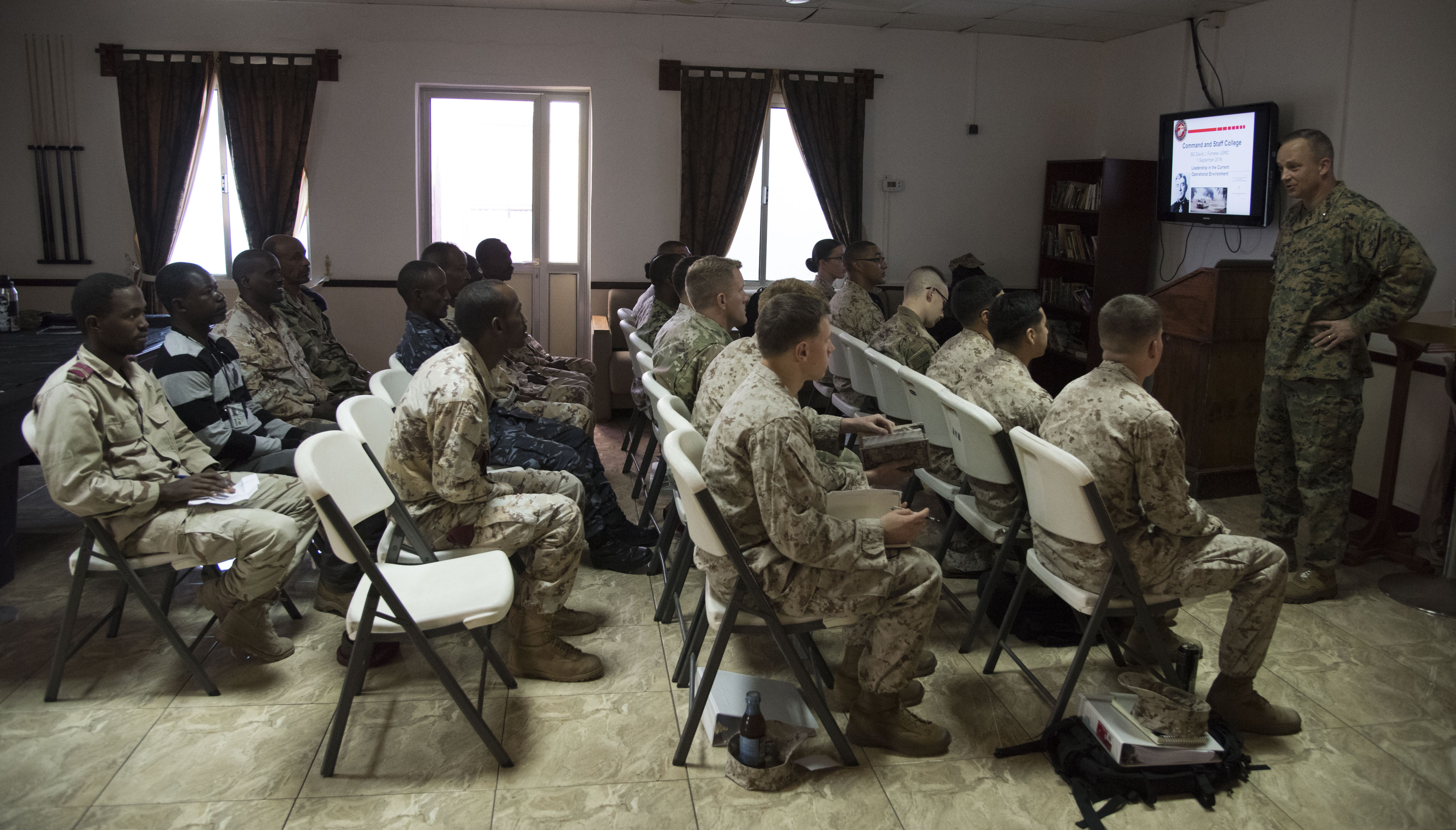 U.S. Marine Corps Brigadier General David Furness, commander of Combined Joint Task Force – Horn of Africa, speaks to U.S. and Djiboutian students about leadership as part of a Joint Corporals Course hosted by Combined Joint Task Force – Horn of Africa at Camp Lemonnier, Jan. 23, 2018. The Joint Corporals Course is designed to provide junior service members with the knowledge and skills necessary to assume leadership roles of greater responsibility as a non-commissioned officer, as well as strengthen bonds between participating militaries. (U.S. Air National Guard photo by Staff Sgt. Allyson L. Manners)