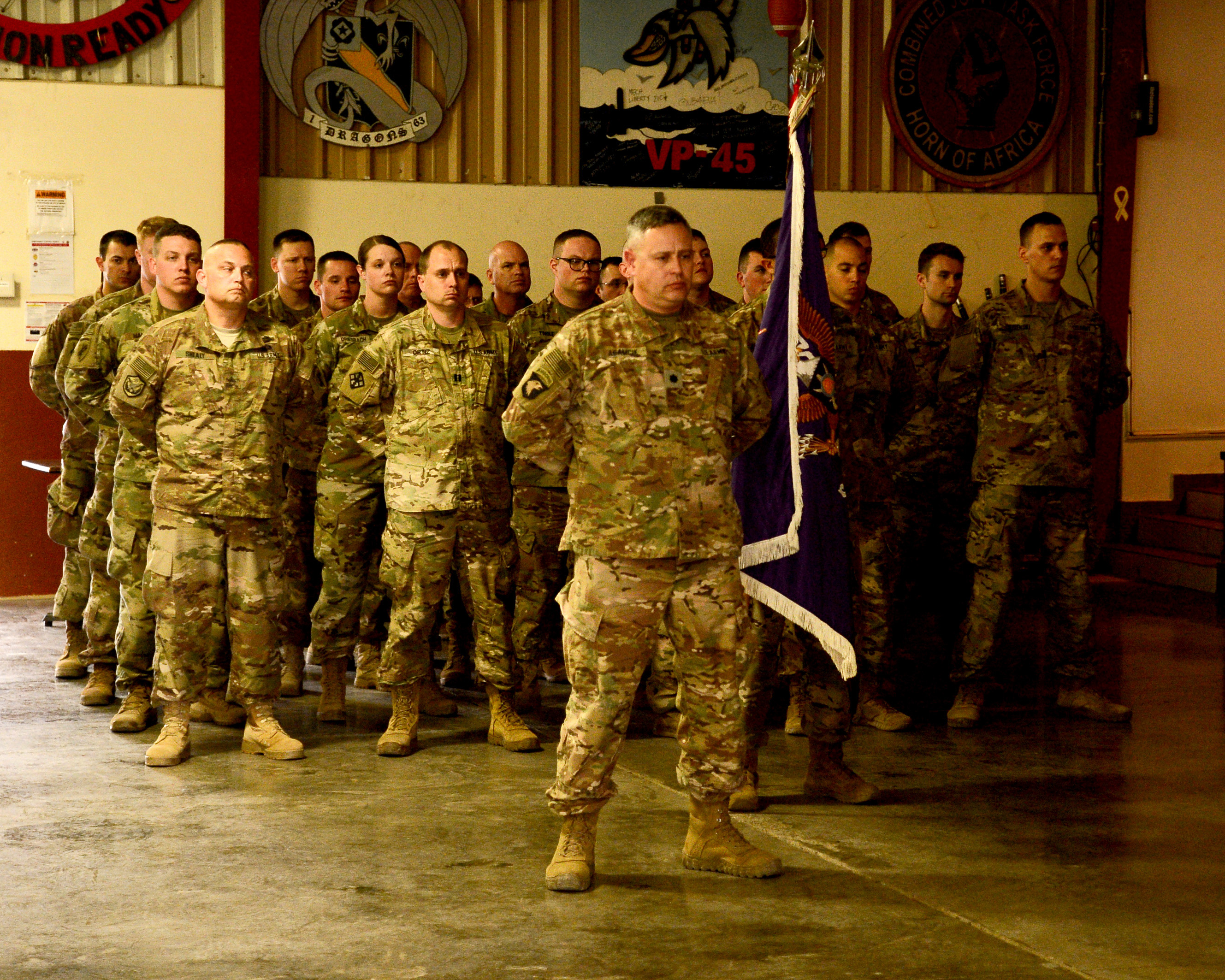 The U.S. Army 404th Civil Affairs Battalion, commanded by U.S. Army Lt. Col. Stefan Adamcik assumed authority from the 443rd Civil Affairs Battalion, at Camp Lemonnier, Djibouti, Feb. 3, 2018. The 404th will conduct military-to-military engagements to strengthen partner nation capacity and relationships with local military forces, civilian populations and civilian authorities. They also advise the Combined Joint Task Force Horn of Africa commanding general on the civil environment. (U.S. Navy Photo by Mass Communication Specialist 2nd Class Timothy M. Ahearn)