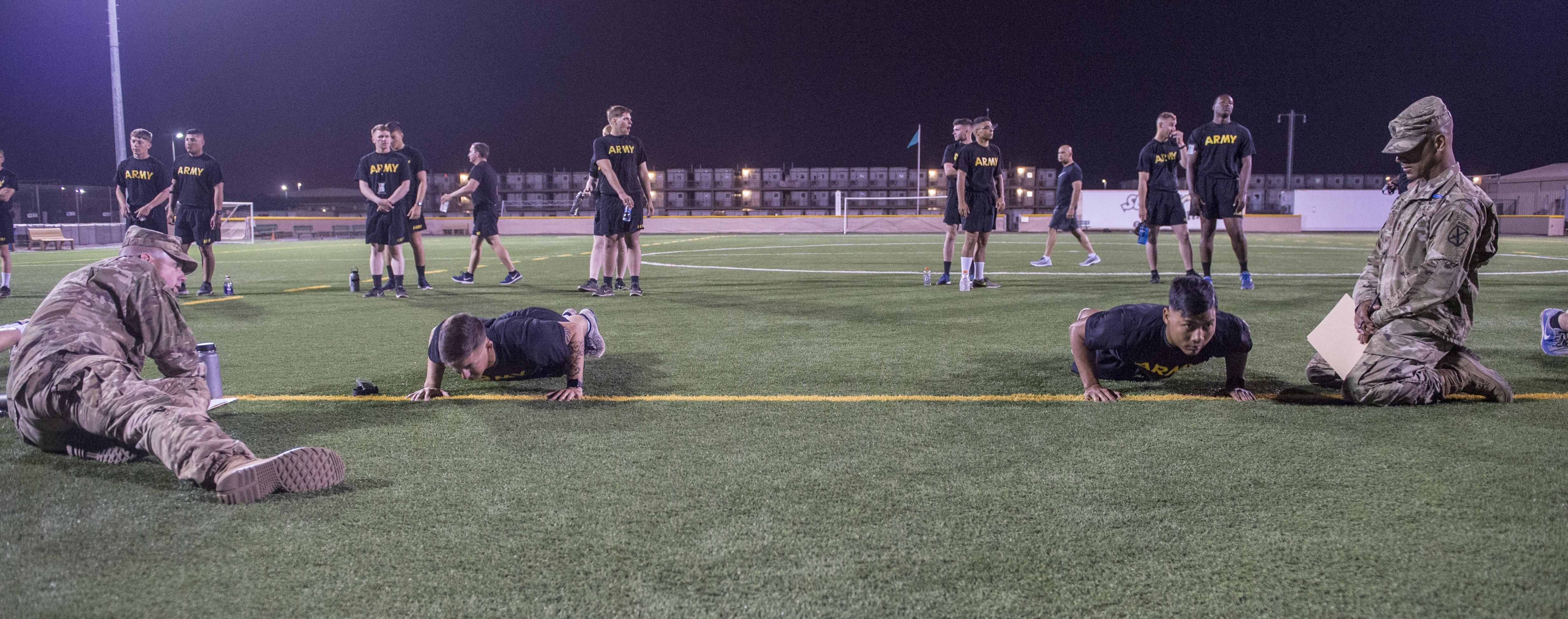 U.S. Army Soldiers assigned to Combined Joint Task Force - Horn of Africa perform pushups during the Army Physical Fitness Test portion of an Expert Infantryman Badge evaluation at Camp Lemonnier, Djibouti, Jan. 29, 2018. After two weeks of training and five days of testing, 50 Soldiers completed the process to earn the coveted special skills badge that requires Soldiers to perform an Army Physical Fitness Test, day and night land navigation, a 12-mile forced march, and 30 individual tasks covering weapons, medical, and security patrol skills. (U.S. Air Force photo by Staff Sgt. Timothy Moore)