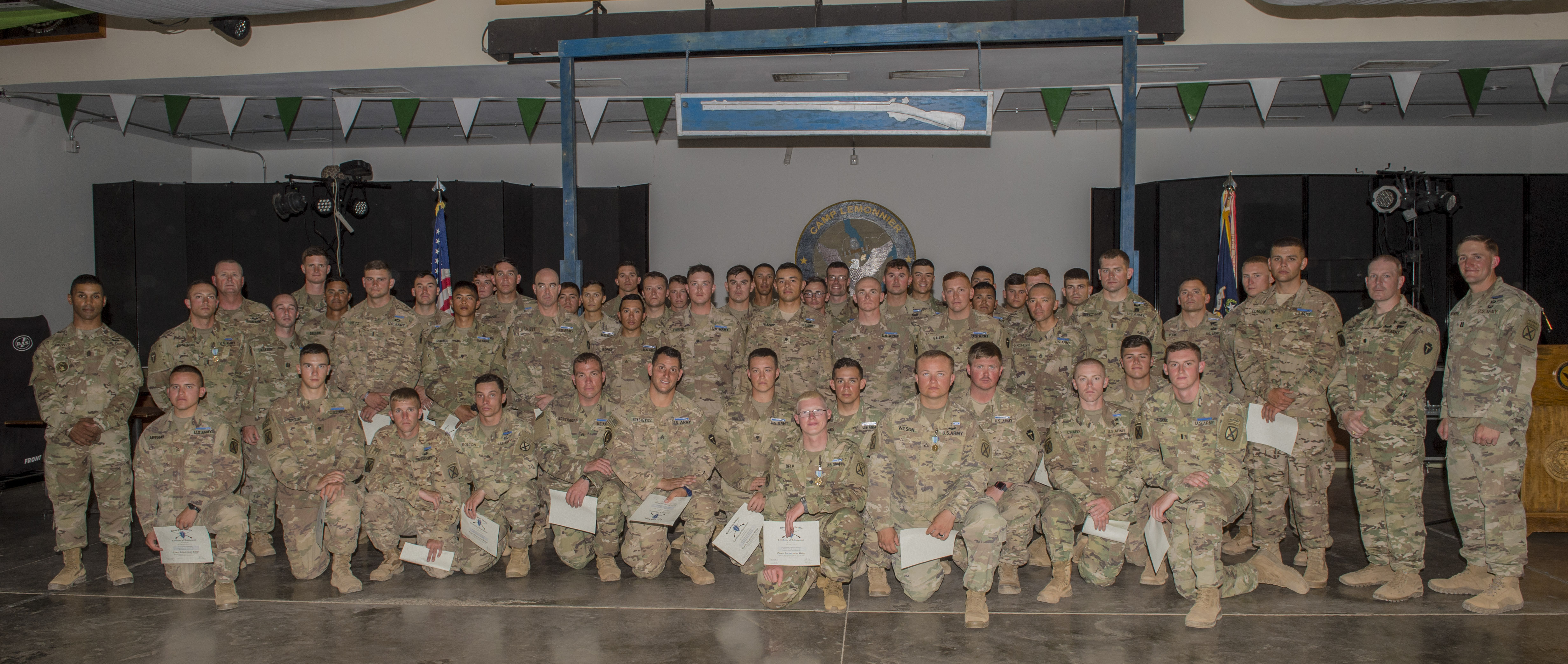 U.S. Army Soldiers assigned to Combined Joint Task Force - Horn of Africa pose for a photo after receiving their Expert Infantryman Badge during a ceremony at Camp Lemonnier, Djibouti, Feb. 2, 2018. After two weeks of training and five days of testing, 50 Soldiers completed the process to earn the coveted special skills badge that requires Soldiers to perform an Army Physical Fitness Test, day and night land navigation, a 12-mile forced march, and 30 individual tasks covering weapons, medical, and security patrol skills.  (U.S. Air Force photo by Staff Sgt. Timothy Moore)