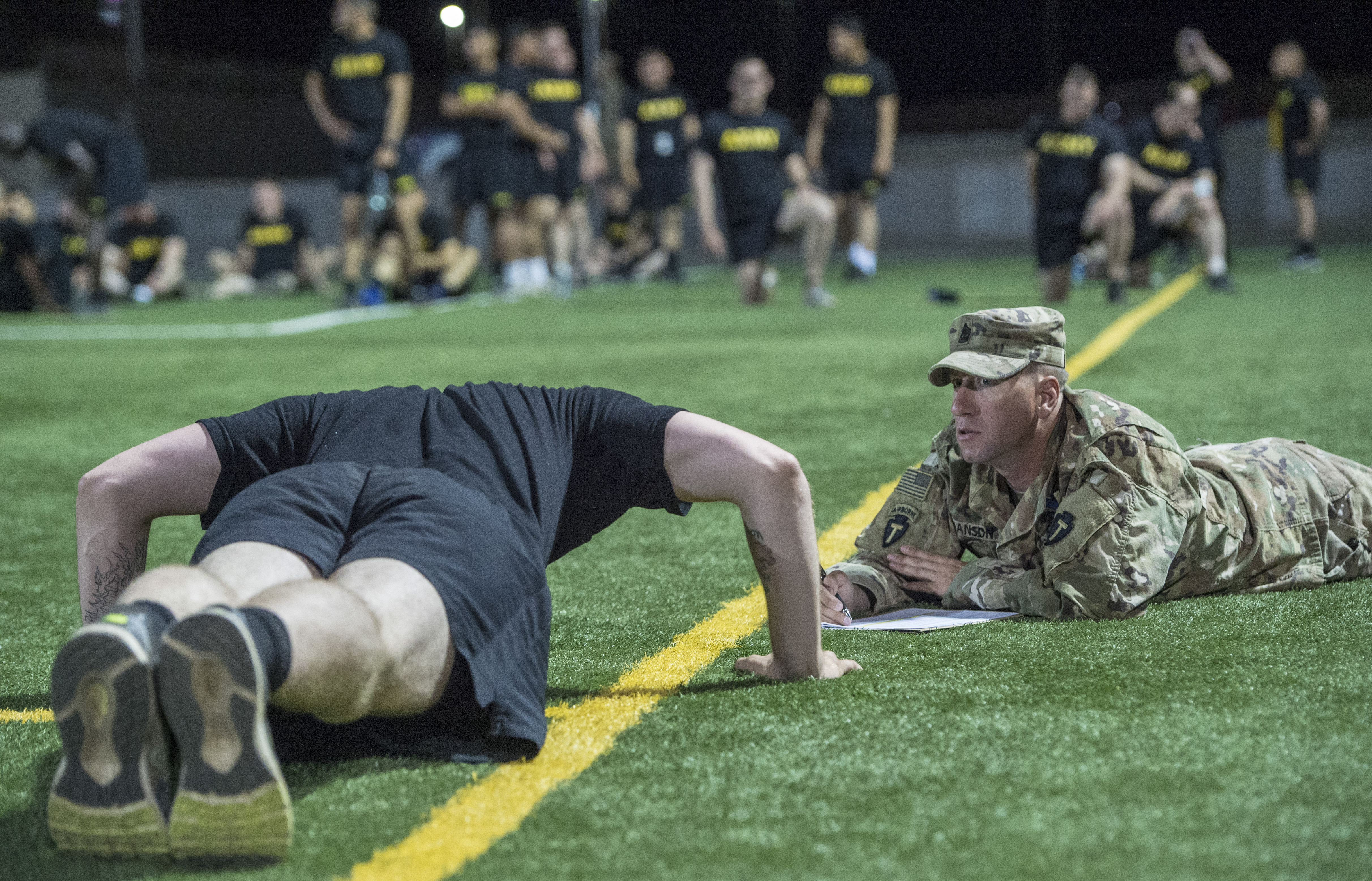 A U.S. Army Soldier assigned to Combined Joint Task Force - Horn of Africa performs a pushup during the Army Physical Fitness Test portion of an Expert Infantryman Badge evaluation at Camp Lemonnier, Djibouti, Jan. 29, 2018. After two weeks of training and five days of testing, 50 Soldiers completed the process to earn the coveted special skills badge that requires Soldiers to perform an Army Physical Fitness Test, day and night land navigation, a 12-mile forced march, and 30 individual tasks covering weapons, medical, and security patrol skills. (U.S. Air Force photo by Staff Sgt. Timothy Moore)