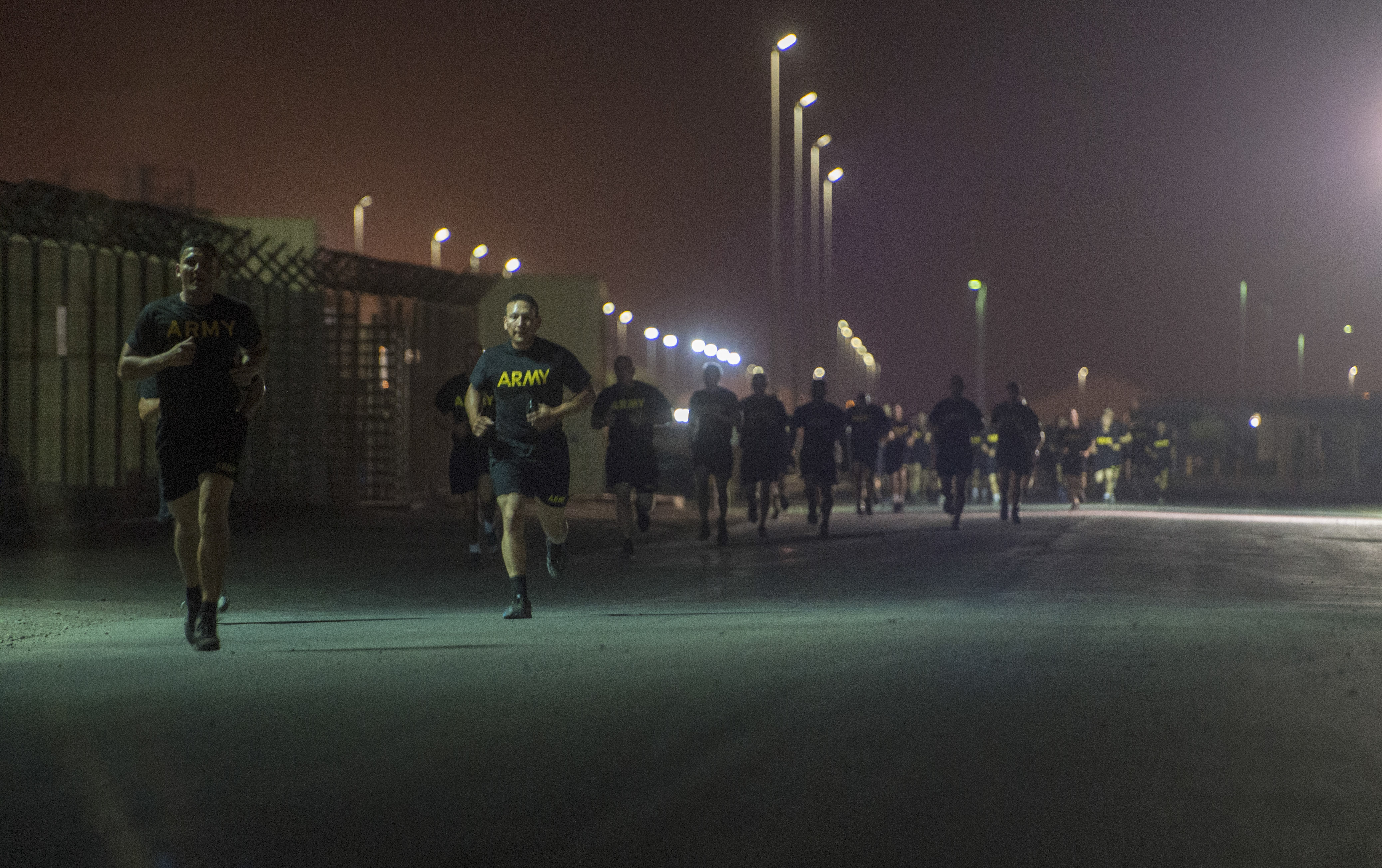 U.S. Army Soldiers assigned to Combined Joint Task Force - Horn of Africa run during the Army Physical Fitness Test portion of an Expert Infantryman Badge evaluation at Camp Lemonnier, Djibouti, Jan. 29, 2018. After two weeks of training and five days of testing, 50 Soldiers completed the process to earn the coveted special skills badge that requires Soldiers to perform an Army Physical Fitness Test, day and night land navigation, a 12-mile forced march, and 30 individual tasks covering weapons, medical, and security patrol skills. (U.S. Air Force photo by Staff Sgt. Timothy Moore)