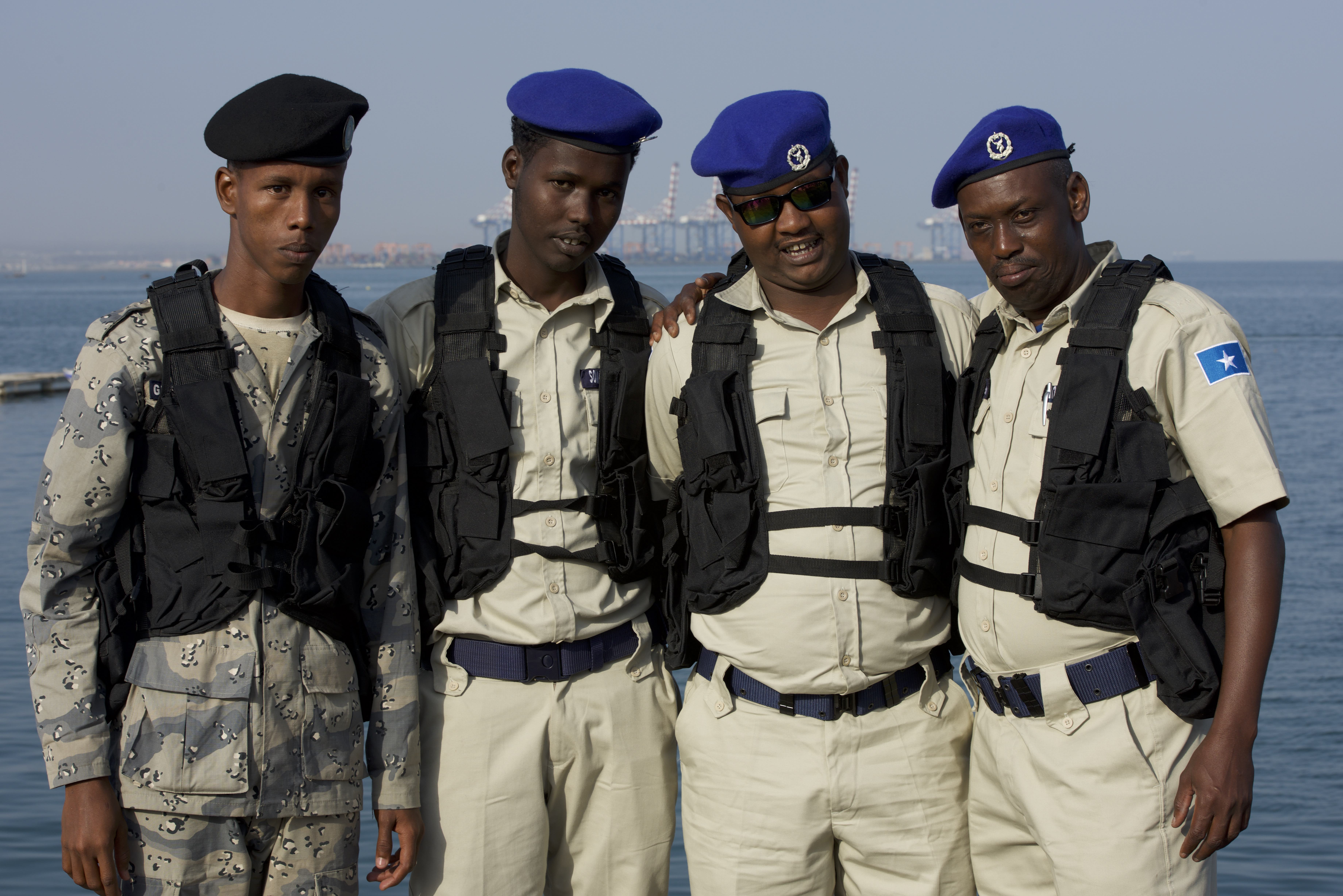 Participants from the Djibouti coast guard and Somali maritime police pose for a photo together during exercise Cutlass Express 2018 in the Port of Djibouti Feb. 5, 2018. Cutlass Express is designed to improve cooperation, maritime domain awareness and information sharing practices to increase capabilities between the U.S., East African and Western Indian Ocean nations. (U.S. Air National Guard photo by Staff Sgt. Allyson Manners)