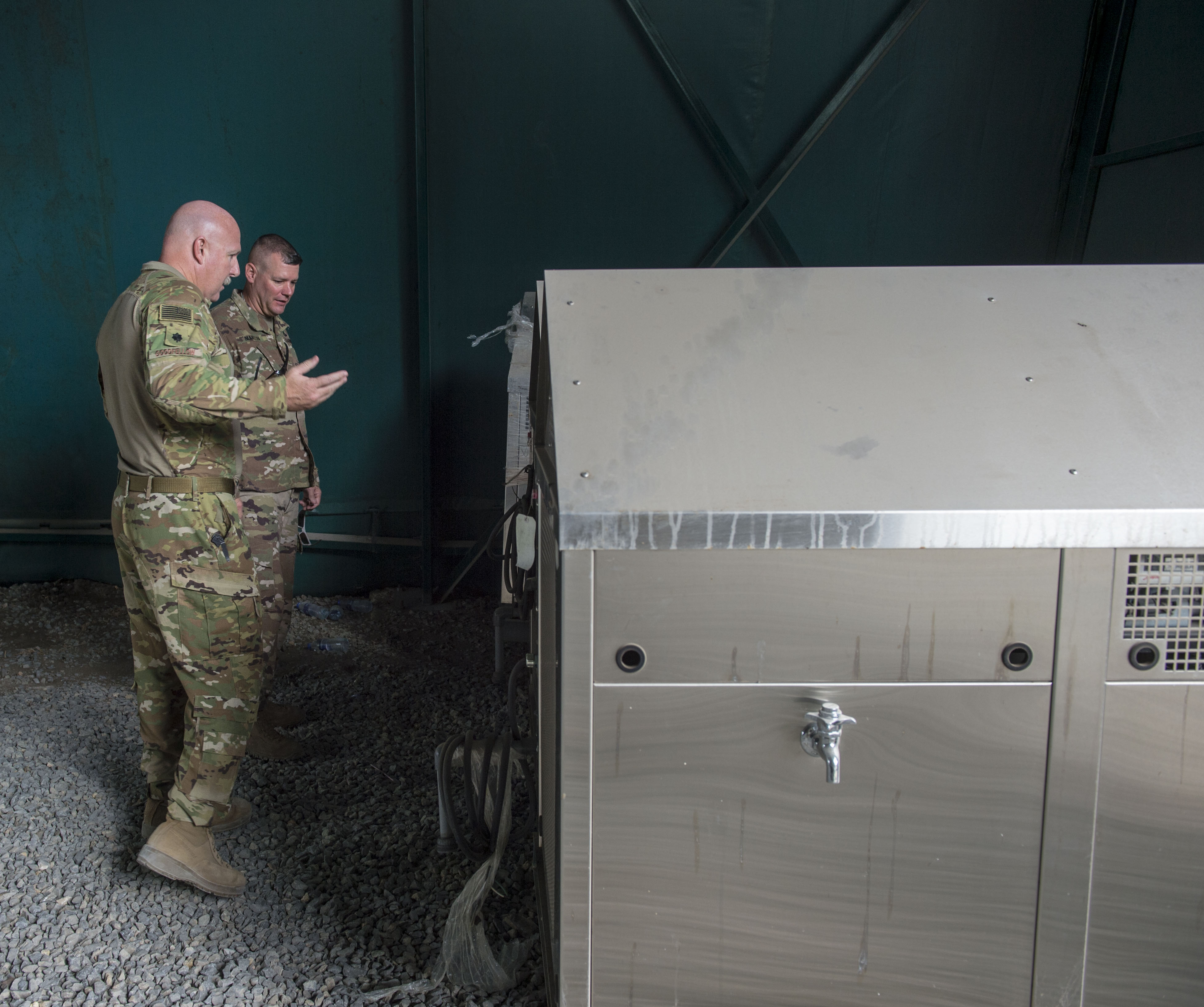 U.S. Air Force Lt. Col. Vance Goodfellow, left, 475th Expeditionary Air Base Squadron (EABS) commander, speaks with U.S. Army Lt. Col. Todd Martin, safety officer assigned to the Combined Joint Task Force - Horn of Africa (CJTF-HOA) Safety directorate, about water tanks during a battlefield circulation site visit at Camp Simba in Manda Bay, Kenya, Feb. 24, 2018. Camp Simba is currently operated by the 475th EABS, who fall under the 435th Air Expeditionary Wing, but the property hosts CJTF-HOA personnel and is in the CJTF-HOA area of operations. As such, the CJTF-HOA Safety and Inspector General directorates provide support to the service members, Department of Defense civilians, and local national contractors who work on the camp. (U.S. Air Force photo by Staff Sgt. Timothy Moore)