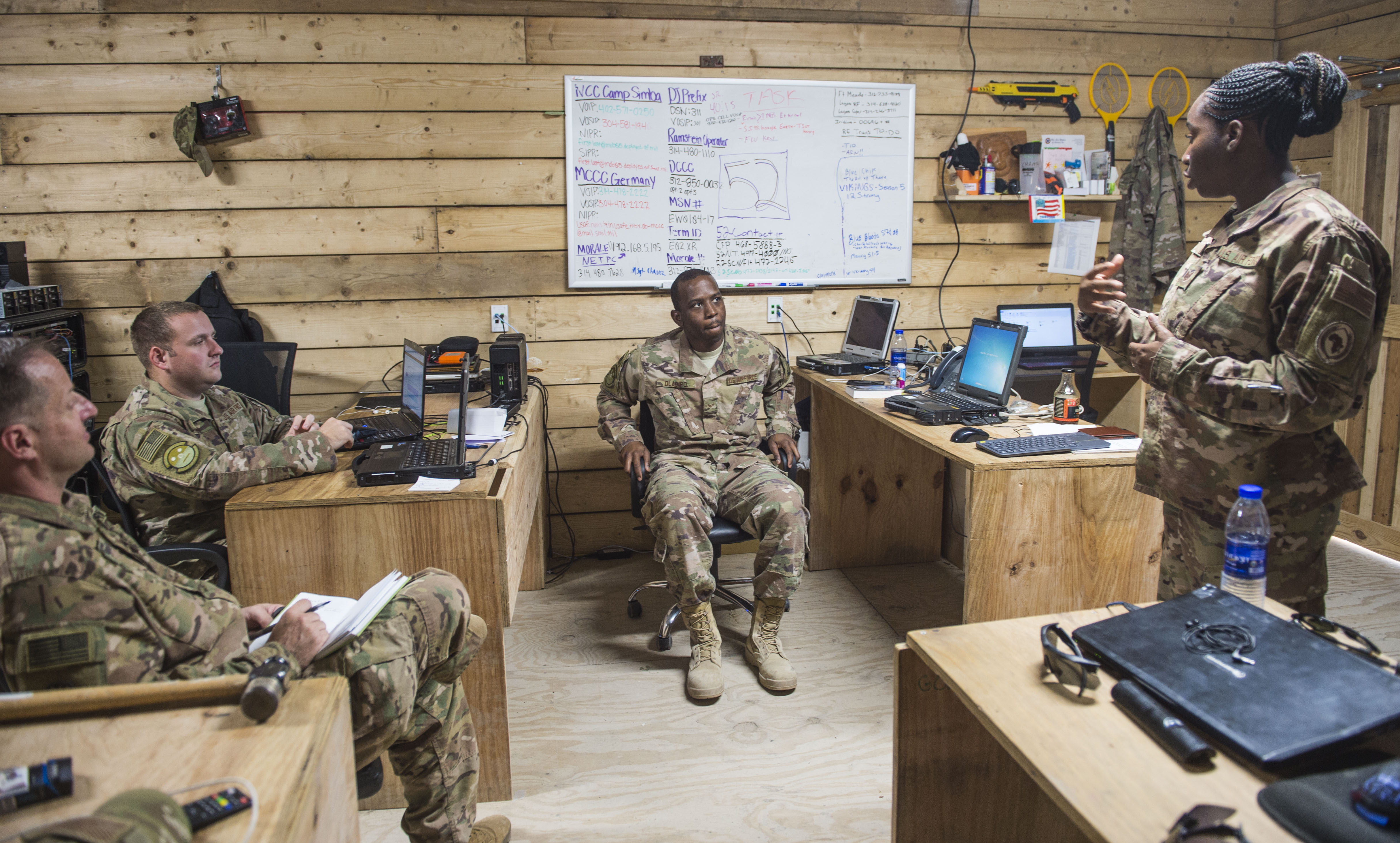 U.S. Army Maj. Robert T. Paul, far left, command inspector general, and U.S. Air Force Tech. Sgt. Starr Day, far right, assistant inspector general, talk with service members during a battlefield circulation site visit at Camp Simba in Manda Bay, Kenya, Feb. 24, 2018. While assigned to the Combined Joint Task Force - Horn of Africa Inspector General directorate, Paul and Day provide support to the service members, Department of Defense civilians, and local national and third-country national contractors who work on the camp. Though many of the members at the camp don't fall under CJTF-HOA's command, many of the concerns that affect the CJTF-HOA personnel at the camp also affect them and vice versa. (U.S. Air Force photo by Staff Sgt. Timothy Moore)