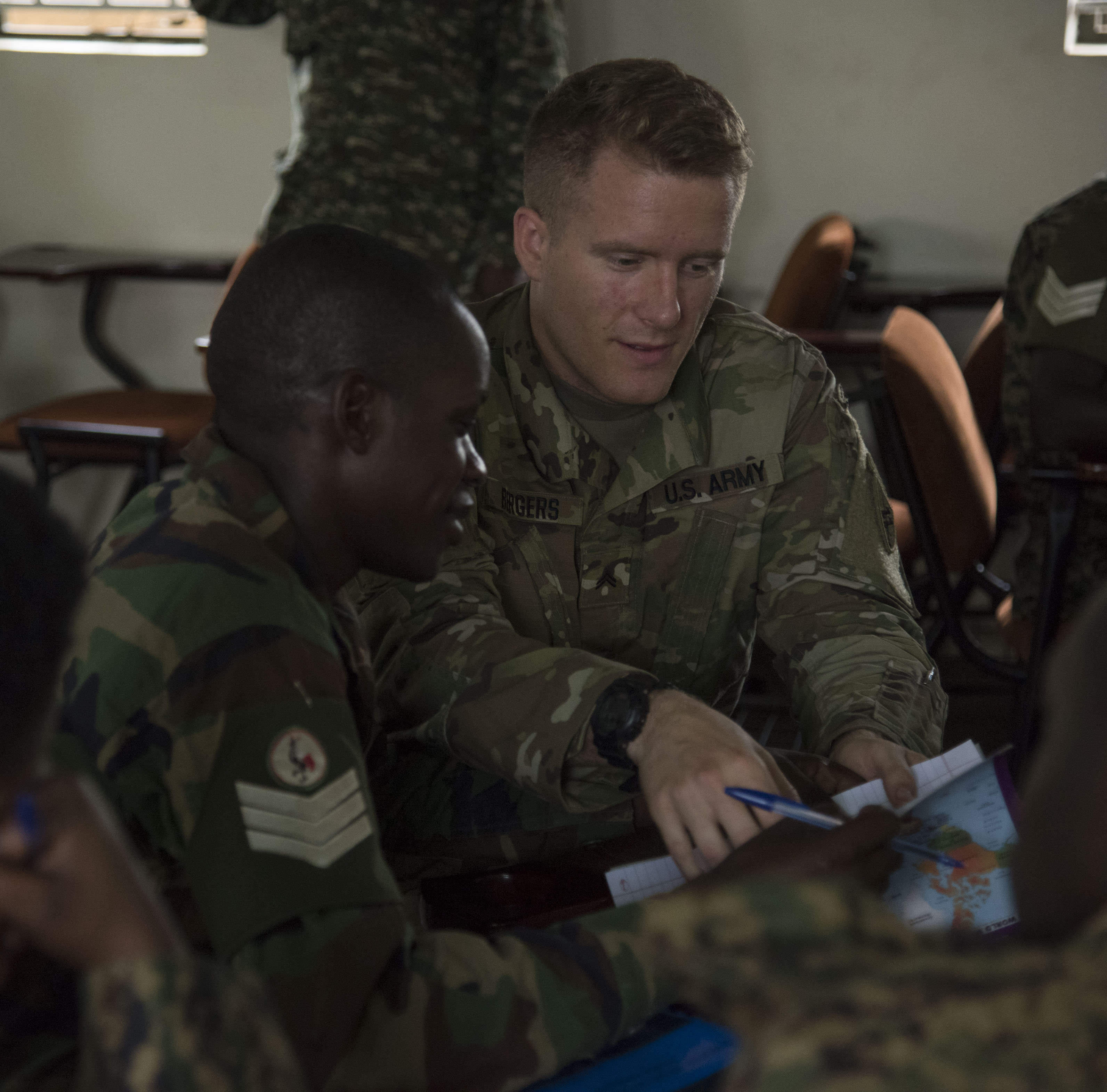 U.S. Army Corporal Shawn Bergers, assigned to the 407th Civil Affairs (CA) Battalion, attached to the Combined Joint Task Force - Horn of Africa, teaches a Civil-Military (CIMIC) course to soldiers from the Uganda People's Defence Force (UPDF) as part of a Civil Affairs Tactical Company Course held at Camp Singo, Uganda, Feb. 08, 2018.  CJTF-HOA service members are forward deployed to Camp Singo to advise and assist the UPDF in preparing Ugandan Battle Group 25 for an upcoming deployment in support of the African Union Mission in Somalia (AMISOM). (U.S. Air National Guard photo by Staff Sgt. Allyson L. Manners)
