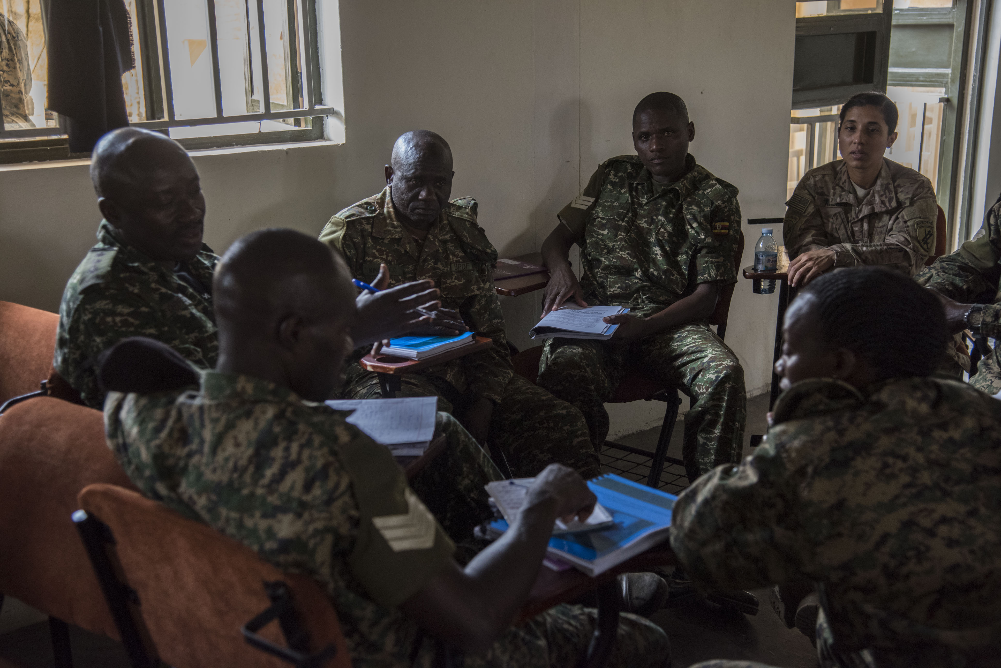 U.S. Army Captain Christine Andreu, assigned to the 407th Civil Affairs (CA) Battalion, attached to the Combined Joint Task Force - Horn of Africa, teaches a Civil-Military (CIMIC) course to soldiers from the Uganda People's Defence Force (UPDF) as part of a Civil Affairs Tactical Company Course held at Camp Singo, Uganda, Feb. 08, 2018.  CJTF-HOA service members are forward deployed to Camp Singo to advise and assist the UPDF in preparing Ugandan Battle Group 25 for an upcoming deployment in support of the African Union Mission in Somalia (AMISOM). (U.S. Air National Guard photo by Staff Sgt. Allyson L. Manners)
