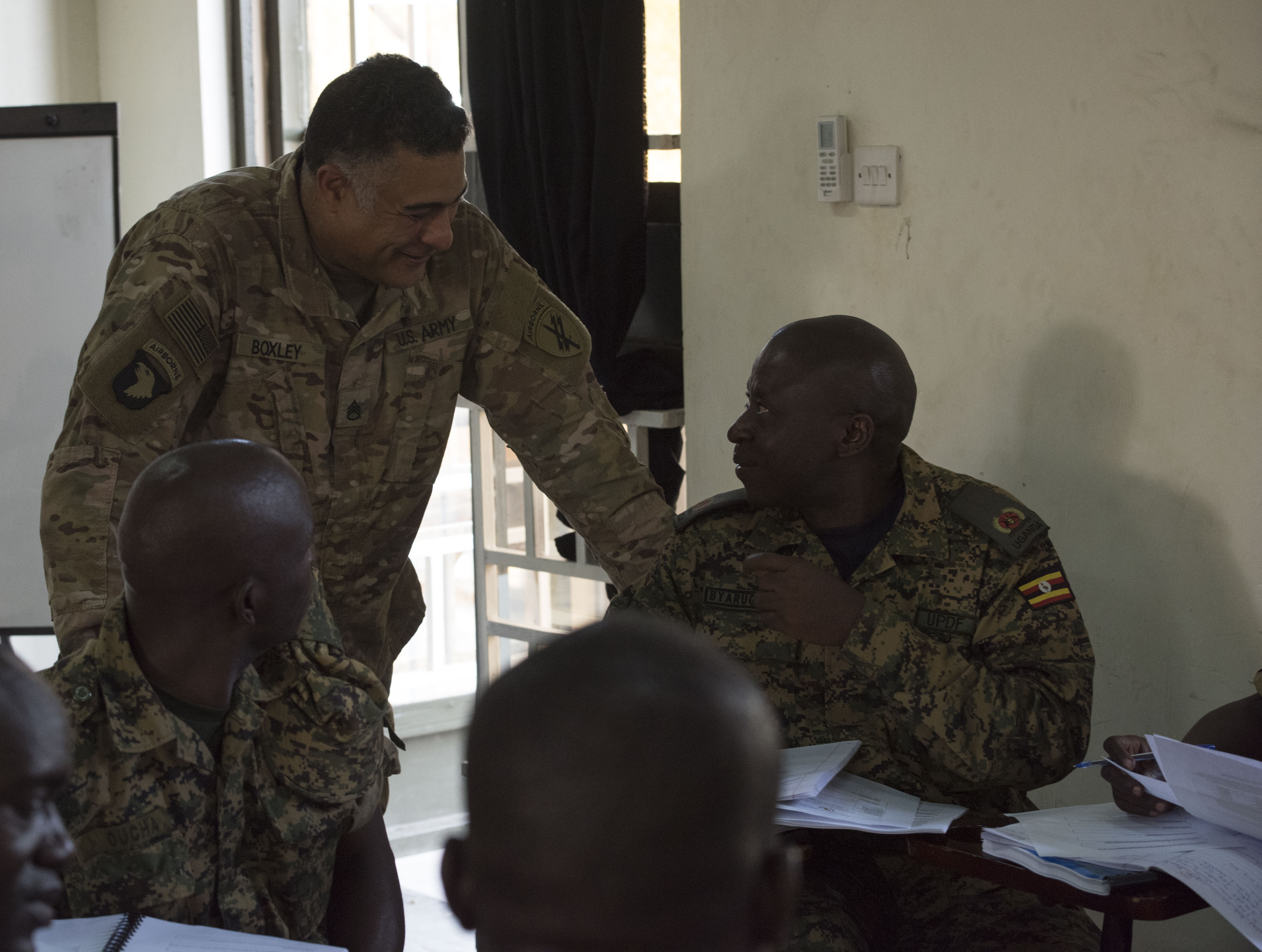 U.S. Army Staff Sgt. Damon Boxley, assigned to the 407th Civil Affairs (CA) Battalion, attached to the Combined Joint Task Force - Horn of Africa, teaches a Civil-Military (CIMIC) course to soldiers from the Uganda People's Defence Force (UPDF) as part of a Civil Affairs Tactical Company Course held at Camp Singo, Uganda, Feb. 08, 2018.  CJTF-HOA service members are forward deployed to Camp Singo to advise and assist the UPDF in preparing Ugandan Battle Group 25 for an upcoming deployment in support of the African Union Mission in Somalia (AMISOM). (U.S. Air National Guard photo by Staff Sgt. Allyson L. Manners)