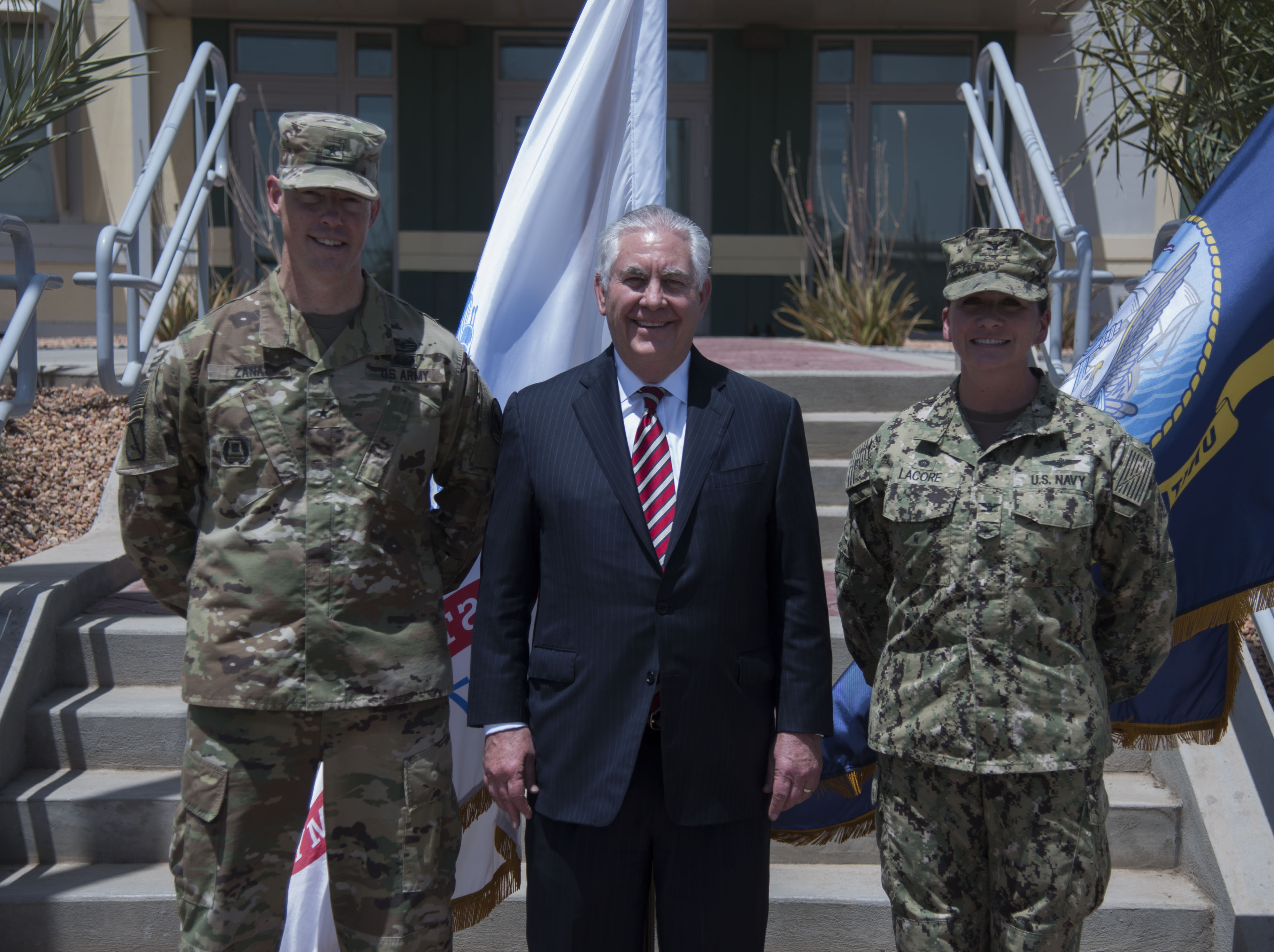 U.S. Secretary of State Rex Tillerson poses for a photo with U.S. Army Brig. Gen. William L. Zana, Deputy Commander of Combined Joint Task Force - Horn of Africa, and U.S. Navy Capt. Nancy S. Lacore, Commander of Camp Lemonnier, at Camp Lemonnier, Djibouti, March 9, 2018. Secretary Tillerson traveled to Djibouti to discuss the U.S.-Djiboutian partnership, and exchanged views on bilateral concerns, security threats, and economic reforms. (U.S. Air National Guard photo by Staff Sgt. Allyson L. Manners)