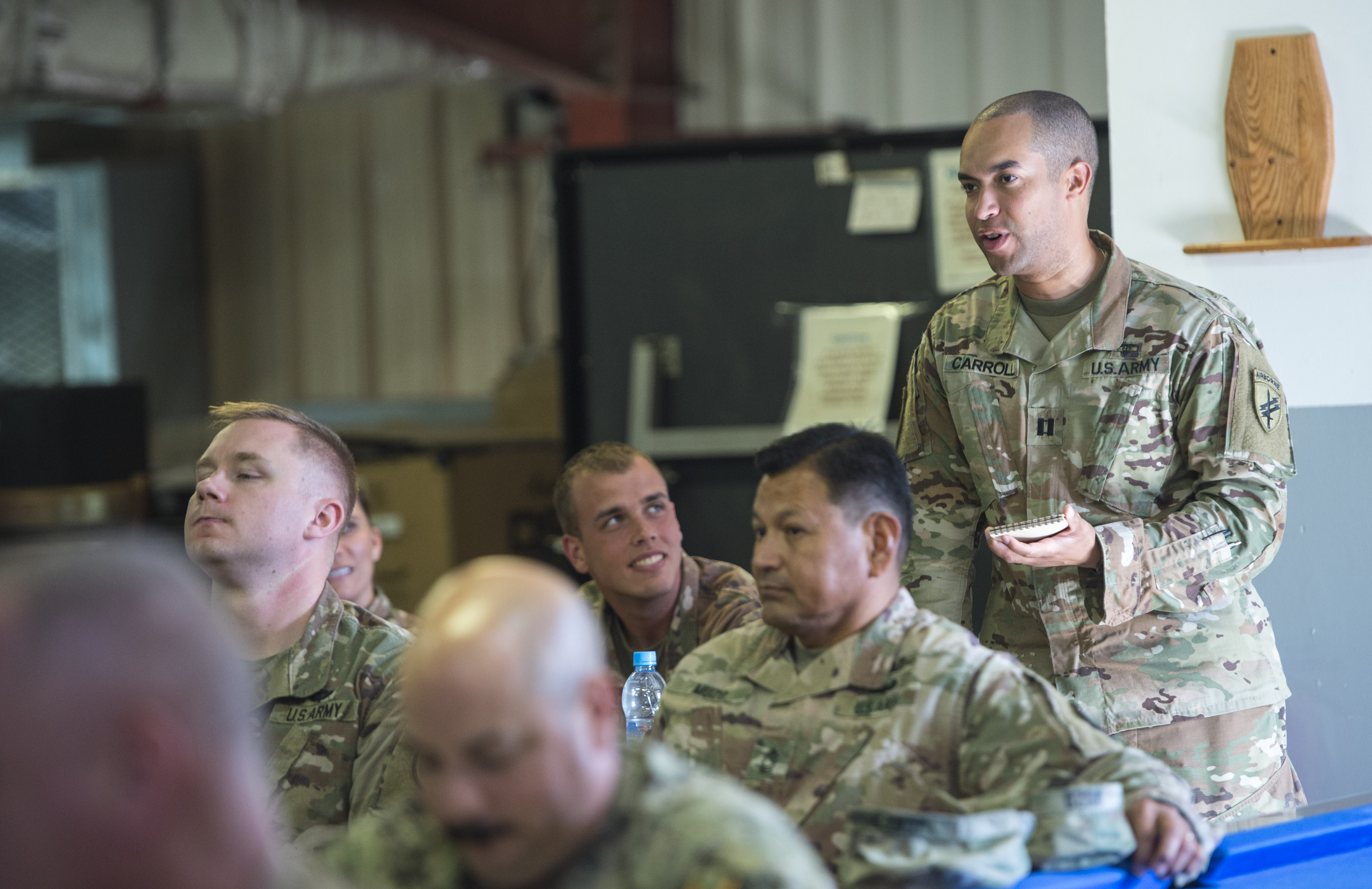 U.S. Army Capt. Sidney Carroll, with the 404th Civil Affairs Battalion, attached to Combined Joint Task Force - Horn of Africa, briefs a plan for military involvement in a simulated disaster relief operation during a U.S. Agency for International Development's Joint Humanitarian Operations Course at Camp Lemonnier, Djibouti, March 9, 2018. Members attended the second two-day course, which highlighted international disaster response, best practices, and the U.S. military's role when supporting humanitarian assistance and disaster relief operations. (U.S. Air Force photo by Staff Sgt. Timothy Moore)