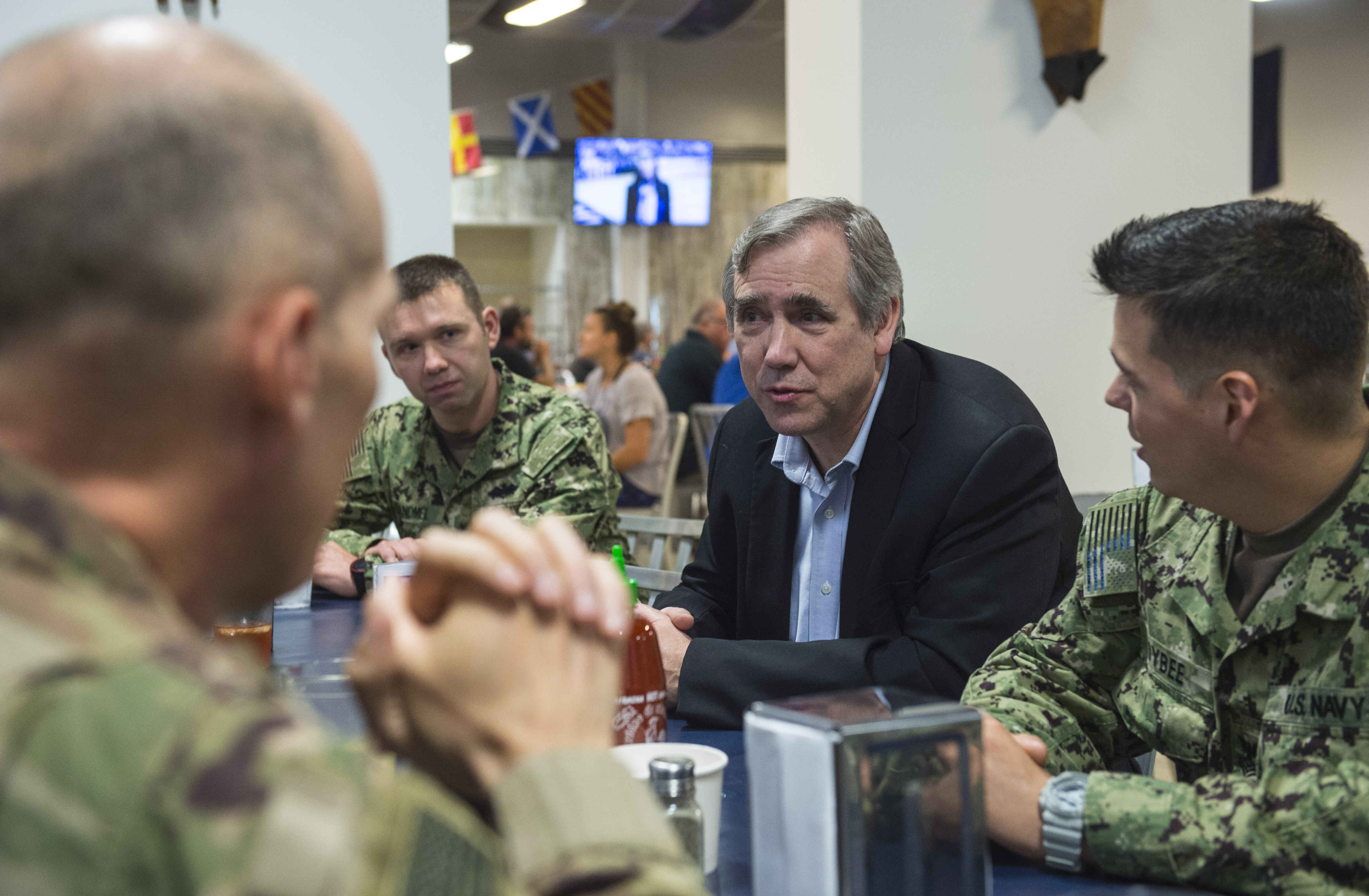 U.S. Sen. Jeff Merkley, Oregon, speaks with service members deployed to Camp Lemonnier, Djibouti, during a visit to the Combined Joint Task Force - Horn of Africa (CJTF-HOA) March 26, 2018. Merkley visited with service members at Camp Lemonnier before continuing his trip to other locations in East Africa. As a member of the U.S. Senate Foreign Relations Committee, Merkley's visit focused on the critical role that U.S. assistance plays as he examined famine-like conditions, severe food shortages, internally displaced persons and refugees in each location and how these factors affect counter-terrorism efforts within the CTJF-HOA area of responsibility. (U.S. Air Force photo by Staff Sgt. Timothy Moore)