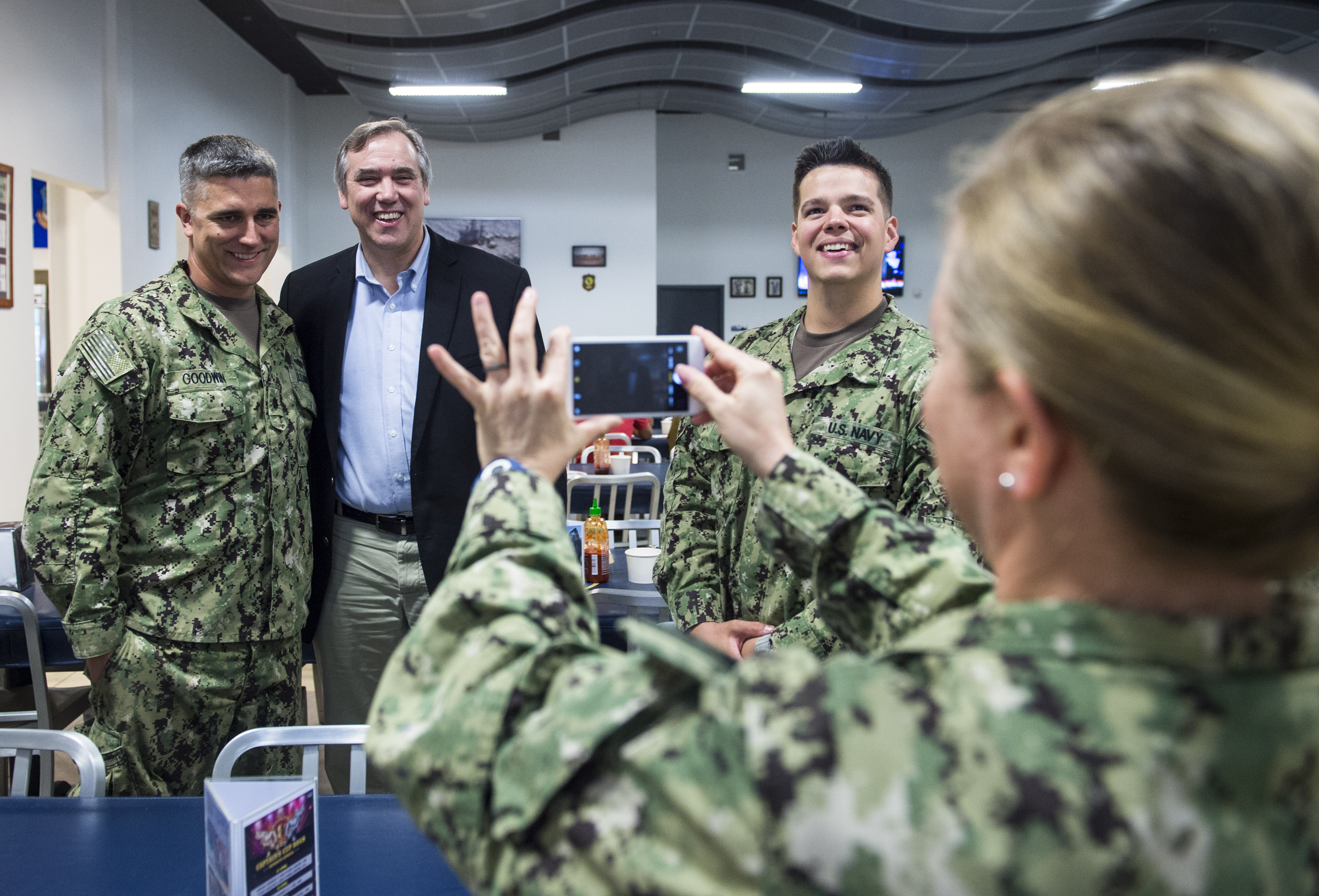 U.S. Sen. Jeff Merkley, Oregon, poses for a photo with a service member deployed to Camp Lemonnier, Djibouti, during a visit to the Combined Joint Task Force - Horn of Africa (CJTF-HOA) March 26, 2018. Merkley visited with service members at Camp Lemonnier before continuing his trip to other locations in East Africa. As a member of the U.S. Senate Foreign Relations Committee, Merkley's visit focused on the critical role that U.S. assistance plays as he examined famine-like conditions, severe food shortages, internally displaced persons and refugees in each location and how these factors affect counter-terrorism efforts within the CTJF-HOA area of responsibility. (U.S. Air Force photo by Staff Sgt. Timothy Moore)