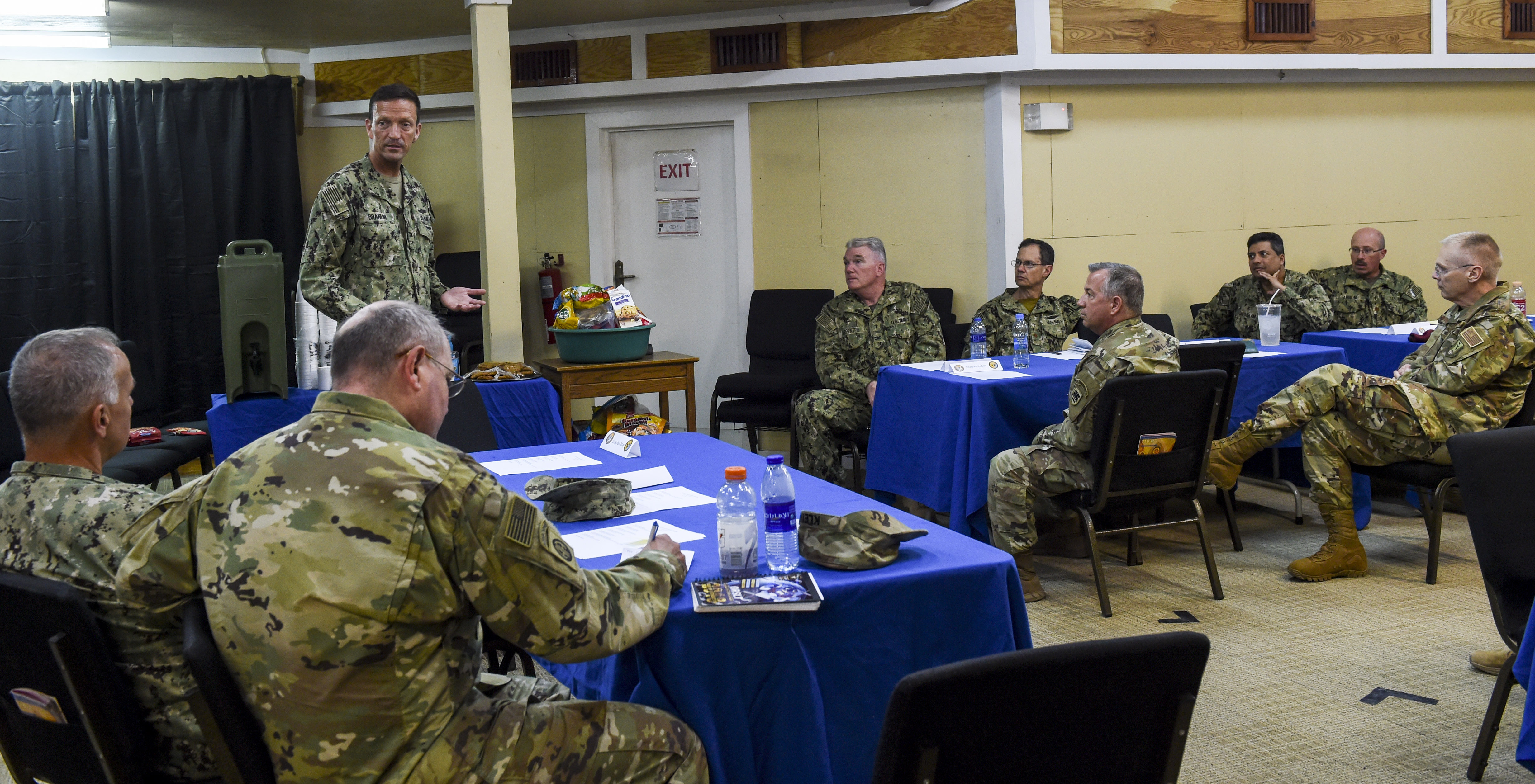 U.S. Navy Capt. Ian Branum, chief of staff for Combined Joint Task Force-Horn of Africa (CJTF-HOA), speaks with chaplains and chaplain assistants from U.S. Africa Command (AFRICOM), U.S. Army Africa (USARAF), and U.S. Air Forces Africa (AFAFRICA) during a religious affairs workshop at Camp Lemonnier, Djibouti, April 11, 2018. The CJTF-HOA Religious Affairs team hosted the workshop to synchronize and plan the support they provide for service members throughout the combined joint operating area. (U.S. Air Force photo by Staff Sgt. Timothy Moore)