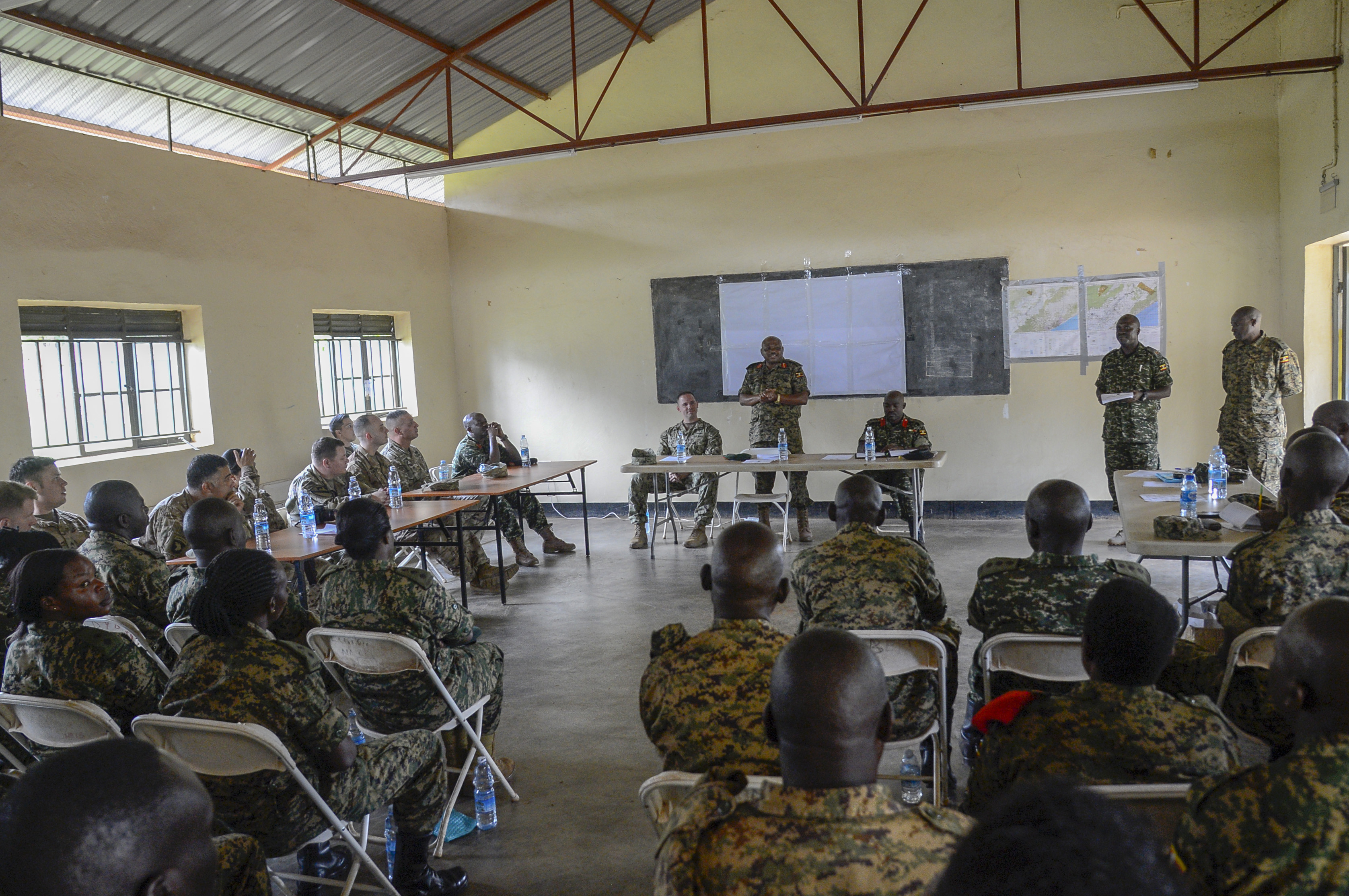 Uganda People's Defense Force (UPDF) Brig. Gen. Jack Backasumba, Camp Singo Commandant, addresses UPDF soldiers during the graduation ceremony for a 10-week civil affairs operations course provided by U.S. Army Soldiers assigned to the 404th Civil Affairs Battalion, at Camp Singo, Uganda, April 13, 2018. The civil affairs course is designed to enhance the UPDF's capability and capacity to support its enduring African Union peacekeeping force and African Union Mission in Somalia mandates through civil military cooperation. (U.S. Navy Photo by Mass Communication Specialist 2nd Class Timothy M. Ahearn)