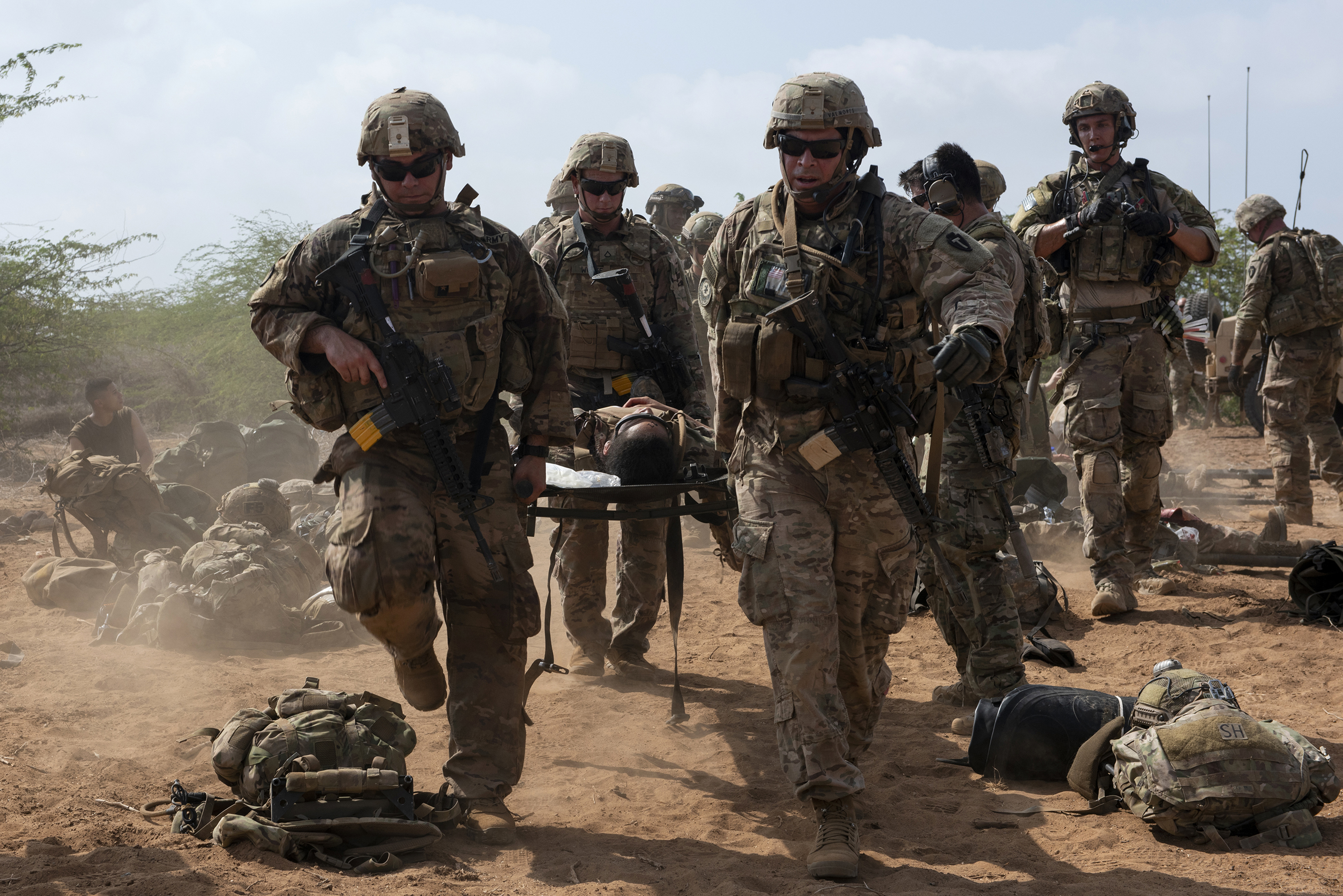 U.S. Soldiers with 3rd Battalion, 144th Infantry Regiment, Texas Army National Guard, transport a simulated casualty on a litter in Djibouti City, Djibouti, April 24, 2018. As part of a joint mass casualty training exercise, service members performed various tasks in order to locate, secure and rescue simulated casualties. (U.S. Air National Guard photo by Master Sgt. Sarah Mattison)