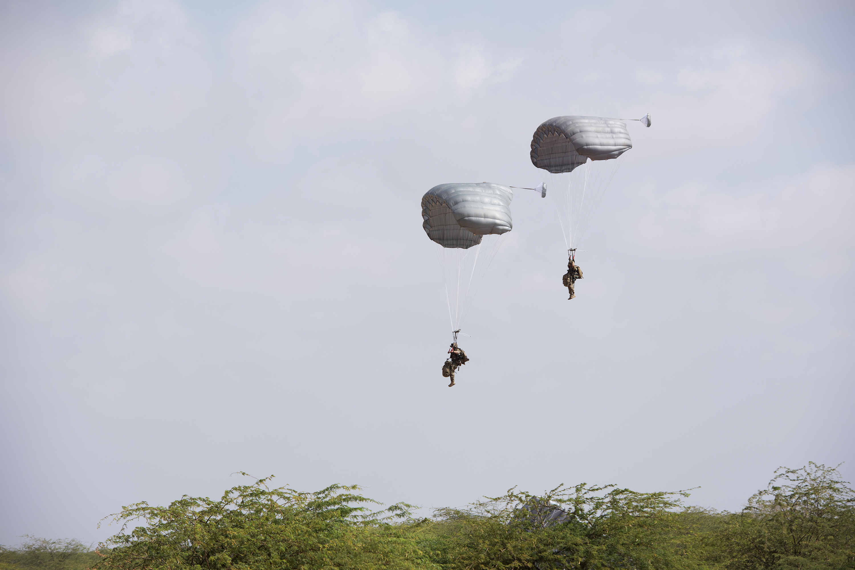 U.S. Air Force Pararescuemen from the 82nd Expeditionary Rescue Squadron participate in a high altitude, low-opening free-fall jump in Djibouti City, Djibouti, April 24, 2018. The free-fall jump was conducted as part of a joint training exercise. (U.S. Air National Guard photo by Master Sgt. Sarah Mattison)