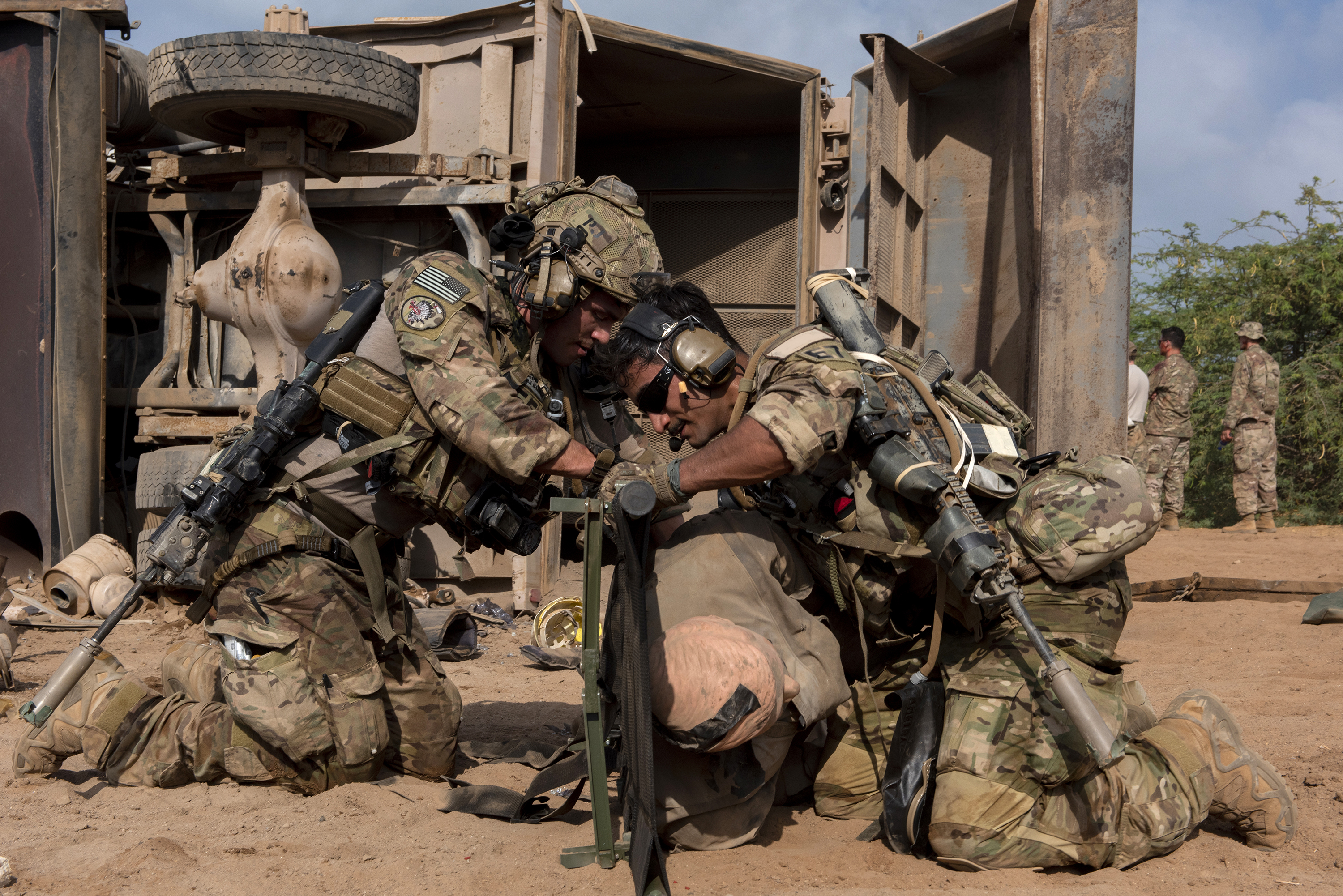 U.S. Air Force Pararescuemen from the 82nd Expeditionary Rescue Squadron load a simulated casualty onto a litter in Djibouti City, Djibouti, April 24, 2018. The Airmen conducted various rescue techniques during a joint mass casualty training exercise. (U.S. Air National Guard photo by Master Sgt. Sarah Mattison) (Portions of this image were obscured for security reasons)