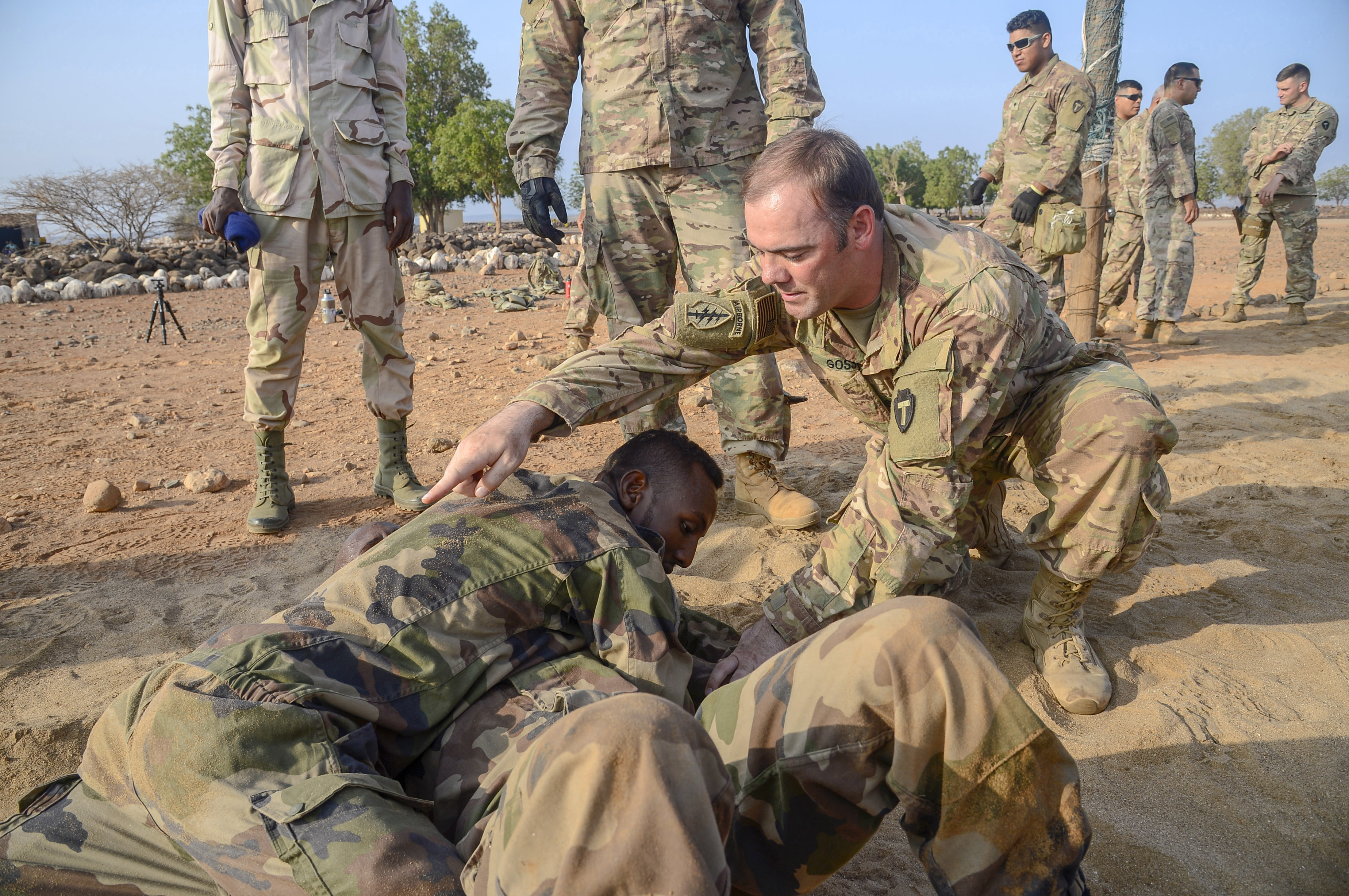 U.S. Army 1st Sergeant Matthew Goss, Charlie Company, 3rd Battalion, 144th Infantry Regiment, Texas National Guard, trains Djiboutian Soldiers in U.S. Army Combatives at a site outside Djibouti City, April 16, 2018. U.S. Army Combatives training is one the courses for the Djiboutian Army's Rapid Intervention Battalion, a newly formed crisis response unit. (U.S. Navy Photo by Mass Communication Specialist 2nd Class Timothy M. Ahearn)