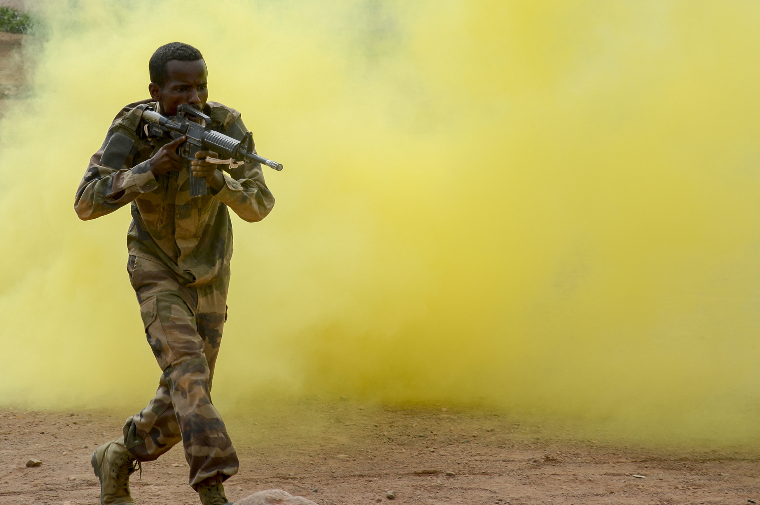 A Djiboutian soldier reacts to simulated contact during the culminating exercise of a five-week training cycle for the newly formed Rapid Intervention Battalion (RIB), a Djiboutian army crisis response unit, at a site outside Djibouti City, May 3, 2018.  U.S. Army Soldiers from Alpha Company, 3rd Battalion, 141st Infantry Regiment, Texas National Guard, assigned to Combined Joint Task Force- Horn of Africa conducted the RIB training. (U.S. Navy Photo by Mass Communication Specialist 2nd Class Timothy M. Ahearn)