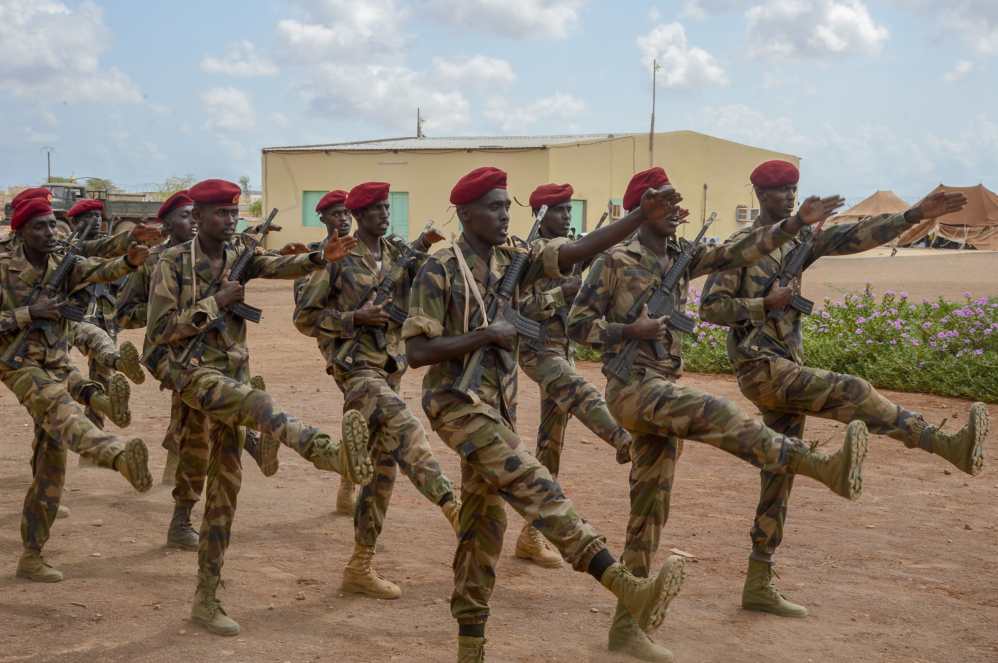 Djiboutian soldiers march in formation following the culminating exercise of a five-week training cycle for the newly formed Rapid Intervention Battalion (RIB), a Djiboutian army crisis response unit, at a site outside Djibouti City, May 3, 2018.  U.S. Army Soldiers from Alpha Company, 3rd Battalion, 141st Infantry Regiment, Texas National Guard, assigned to Combined Joint Task Force- Horn of Africa conducted the RIB training. (U.S. Navy Photo by Mass Communication Specialist 2nd Class Timothy M. Ahearn)
