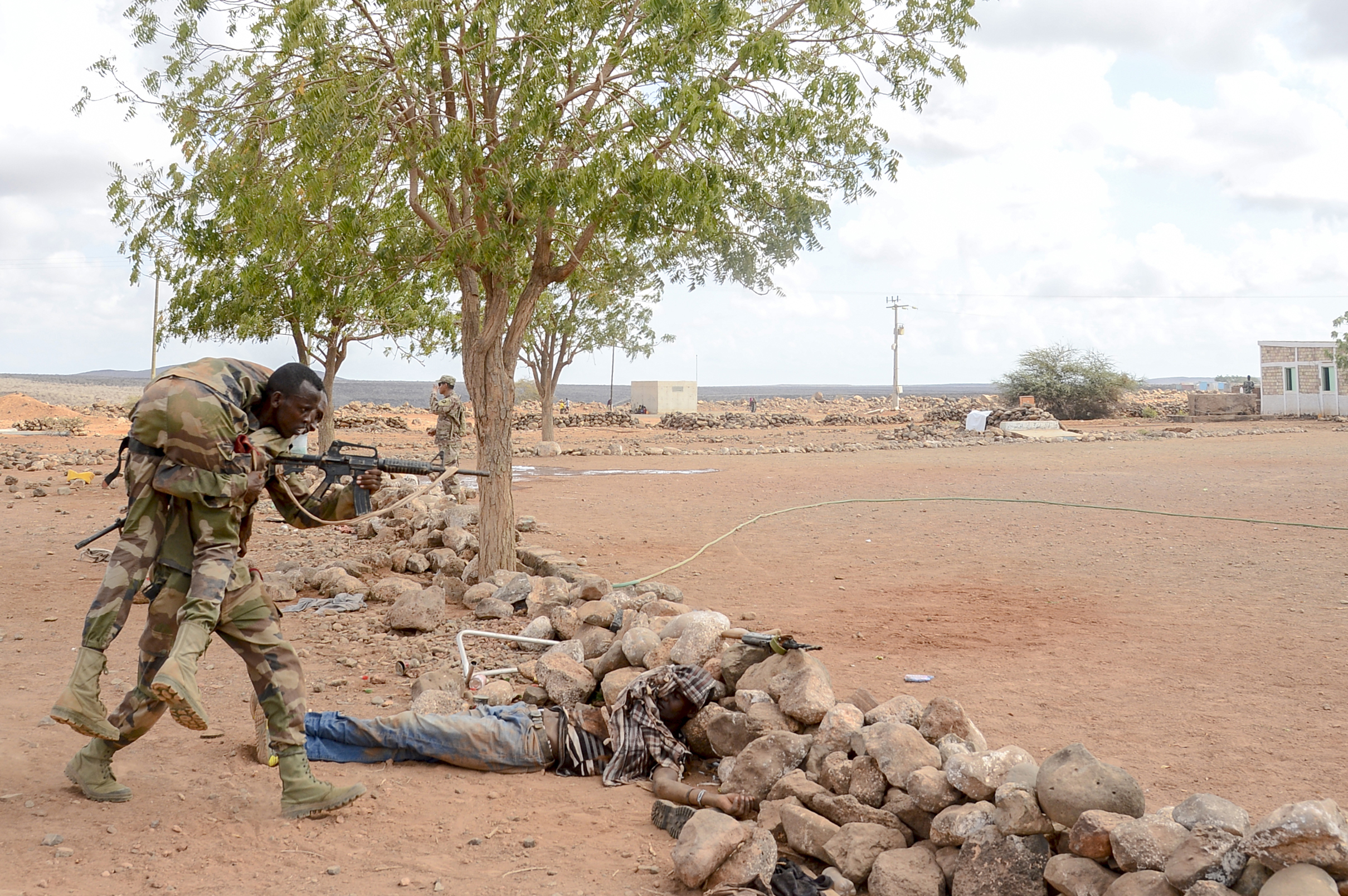 A Djiboutian soldier evacuates a simulated casualty during the culminating exercise of a five-week training cycle for the newly formed Rapid Intervention Battalion (RIB), a Djiboutian army crisis response unit, at site outside Djibouti City, May 3, 2018.  U.S. Army Soldiers from Alpha Company, 3rd Battalion, 141st Infantry Regiment, Texas National Guard, assigned to Combined Joint Task Force- Horn of Africa conducted the RIB training. (U.S. Navy Photo by Mass Communication Specialist 2nd Class Timothy M. Ahearn)
